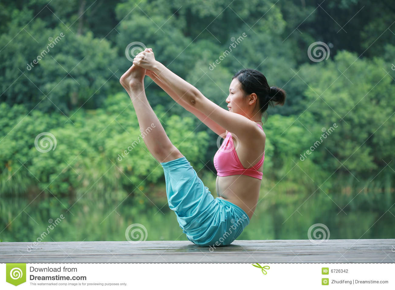 Download Young Chinese Woman Practicing Yoga Outdoor Stock Photo