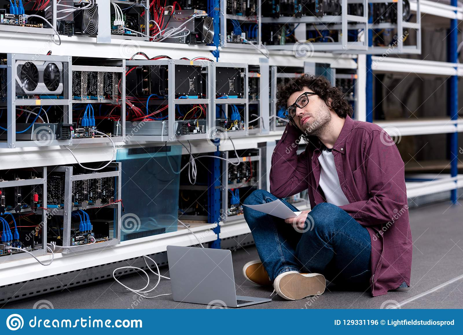 Young computer engineer at ethereum mining farm royalty free stock image