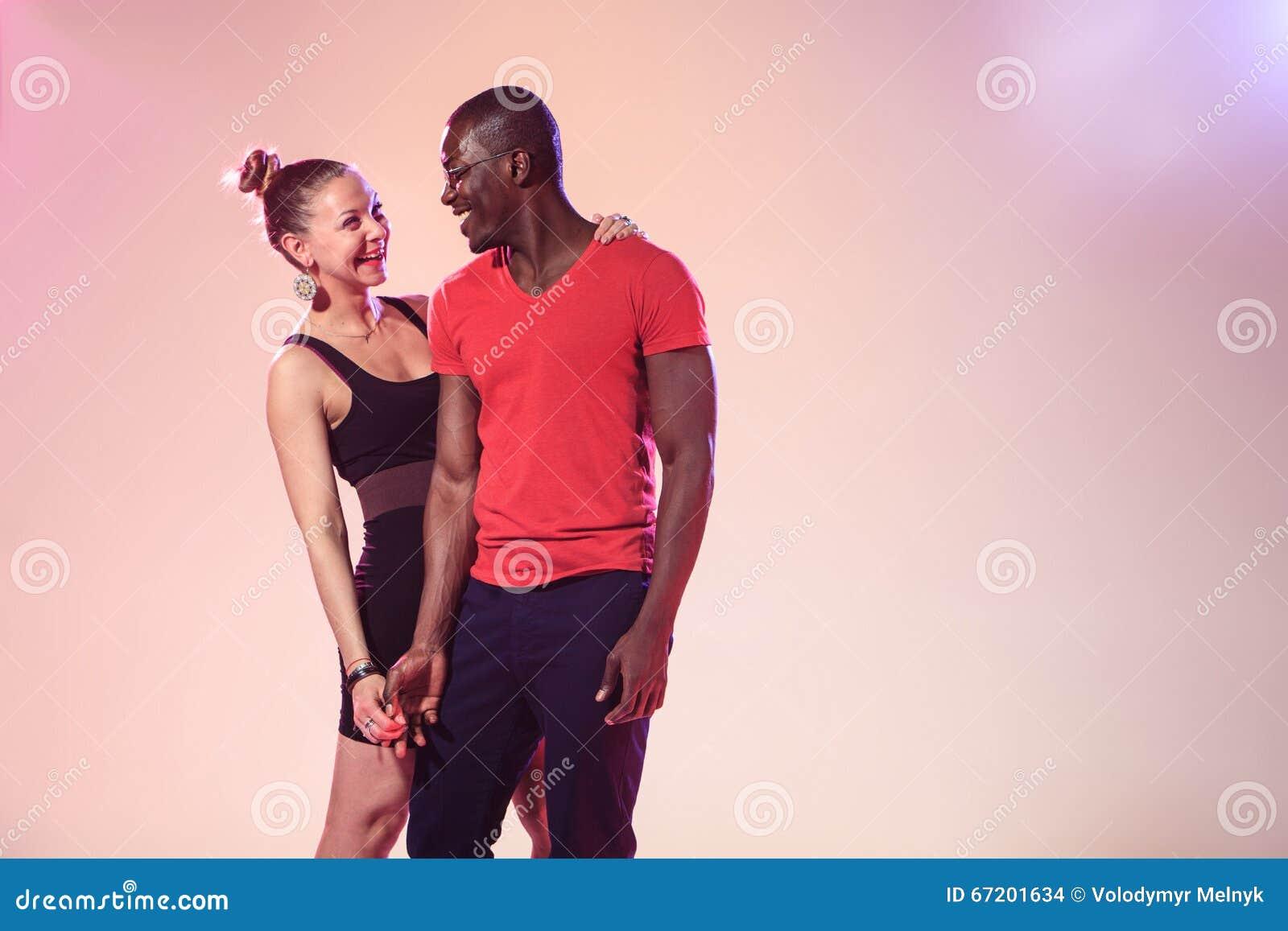man Posing with white girl black