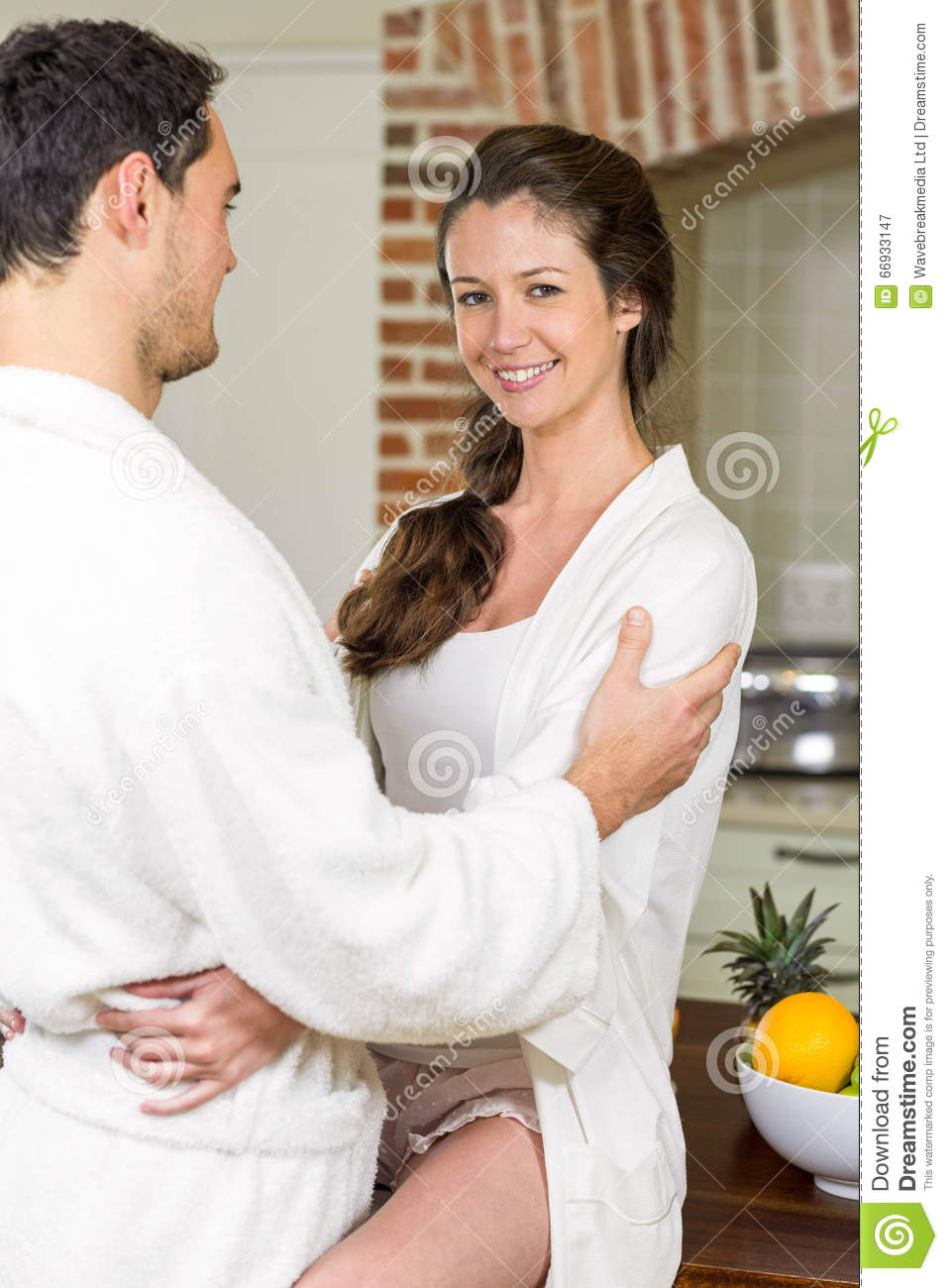 Young Couple In Bathrobe Cuddling Each Other Stock Image - Image of ...