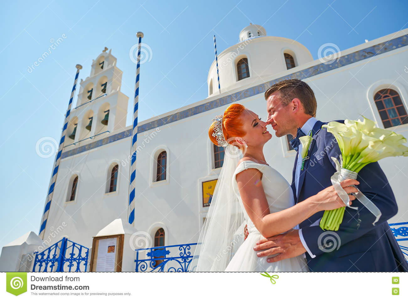 Young couple bride and groom celebrate wedding on Santorini