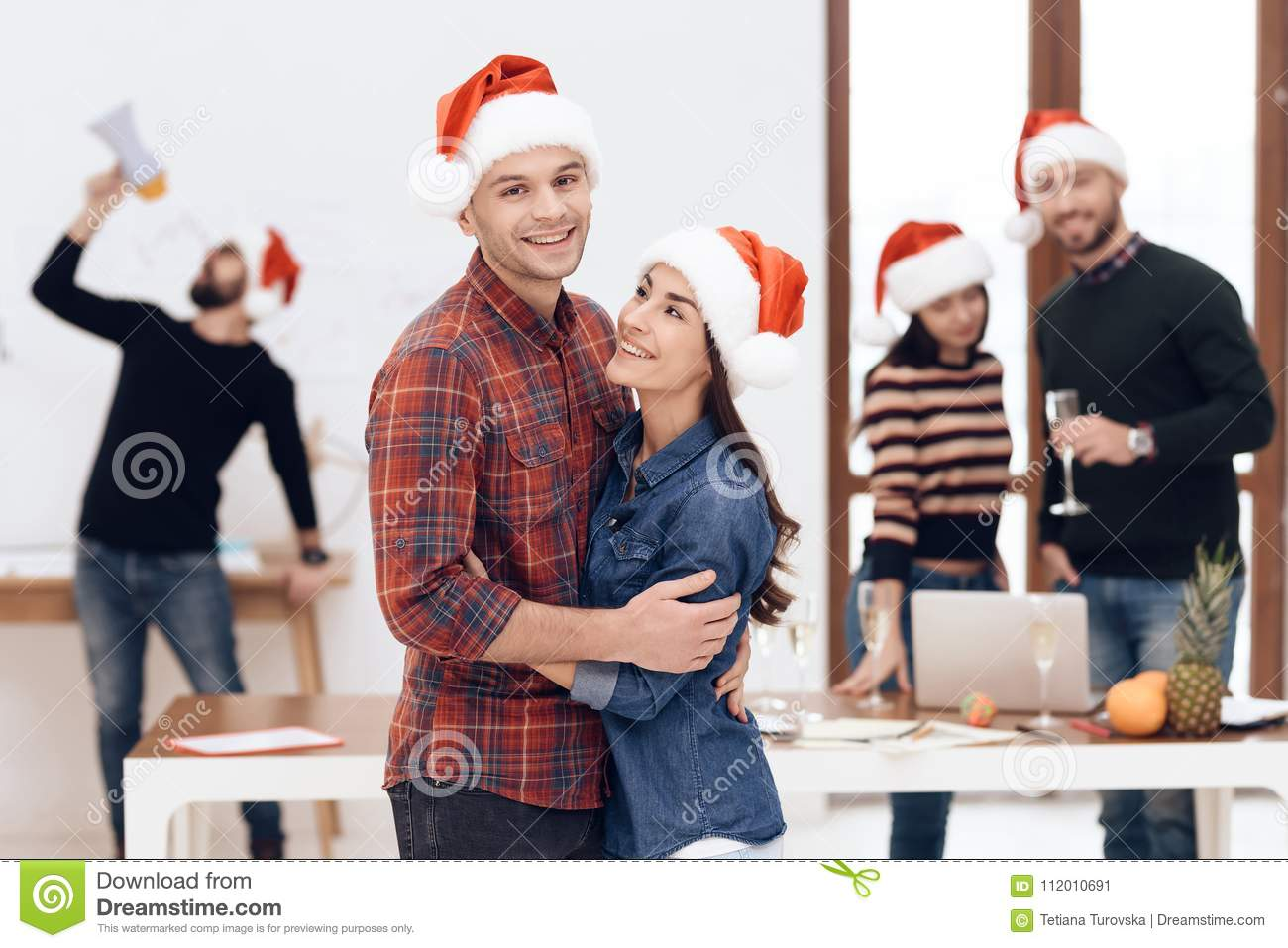 A young couple celebrates at a corporate celebration.