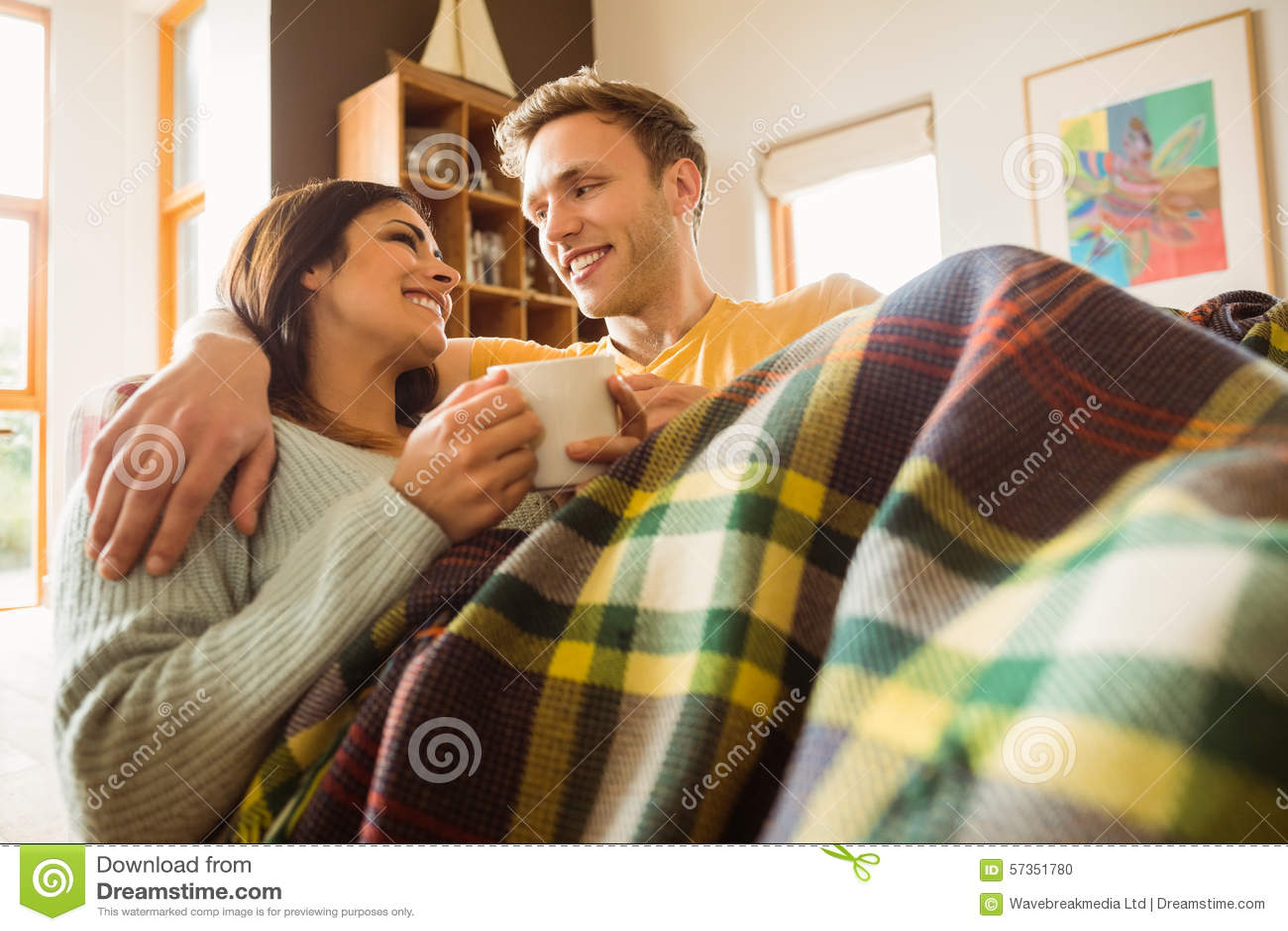 Cuddling under a blanket