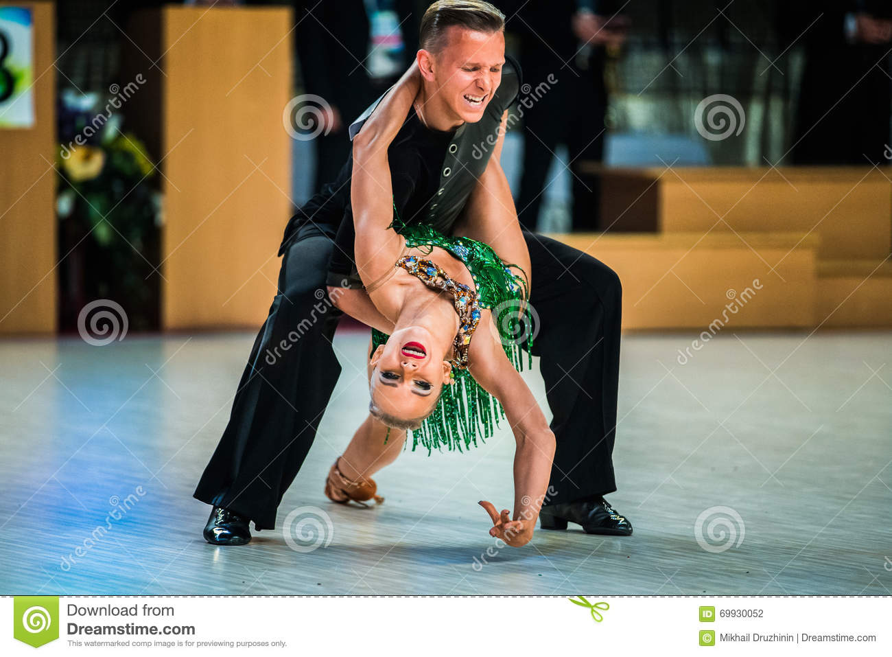Young couple dancers performance at event