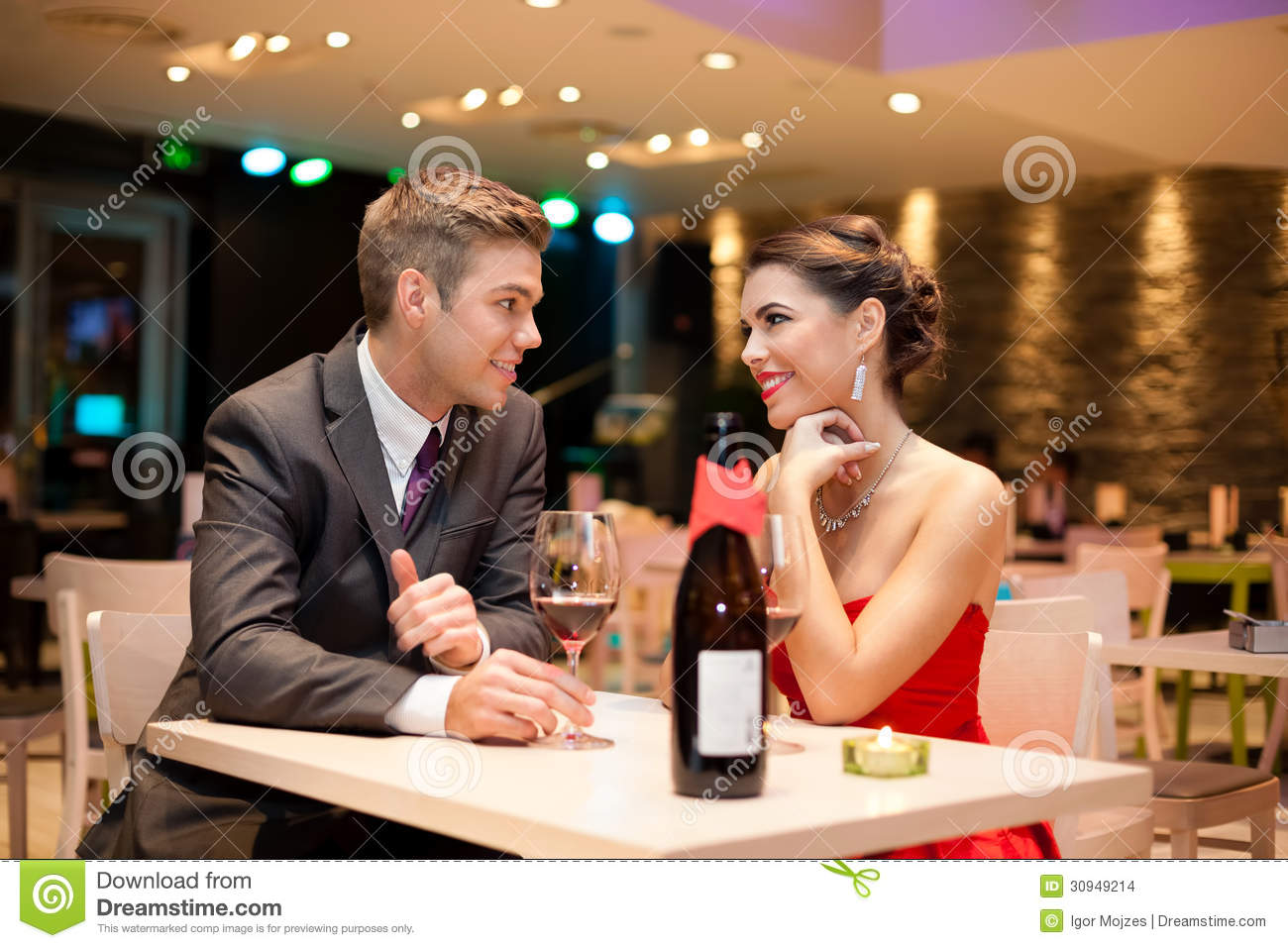 ... happy couple romantic date at restaurant, celebrating valentine day