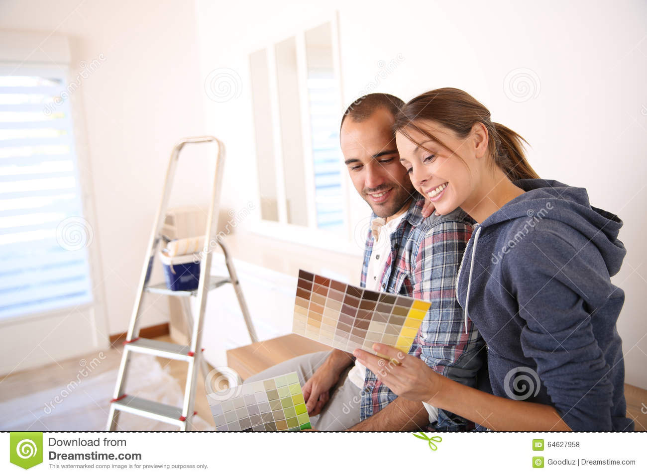 Young Couple Decorating Their New Home Stock Photo - Image ...