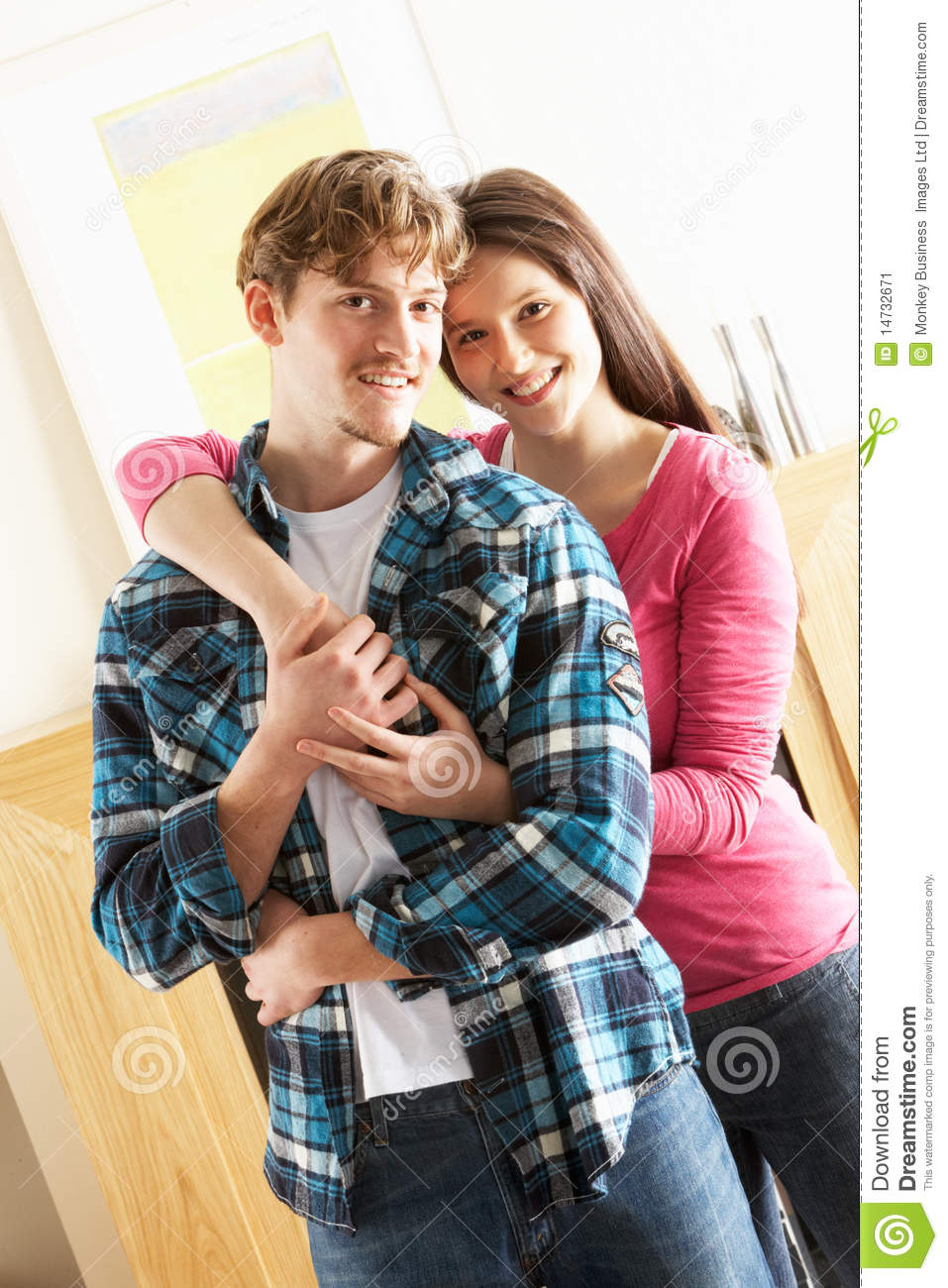 Young couple embracing in living room stock image image for Living room ideas young couples