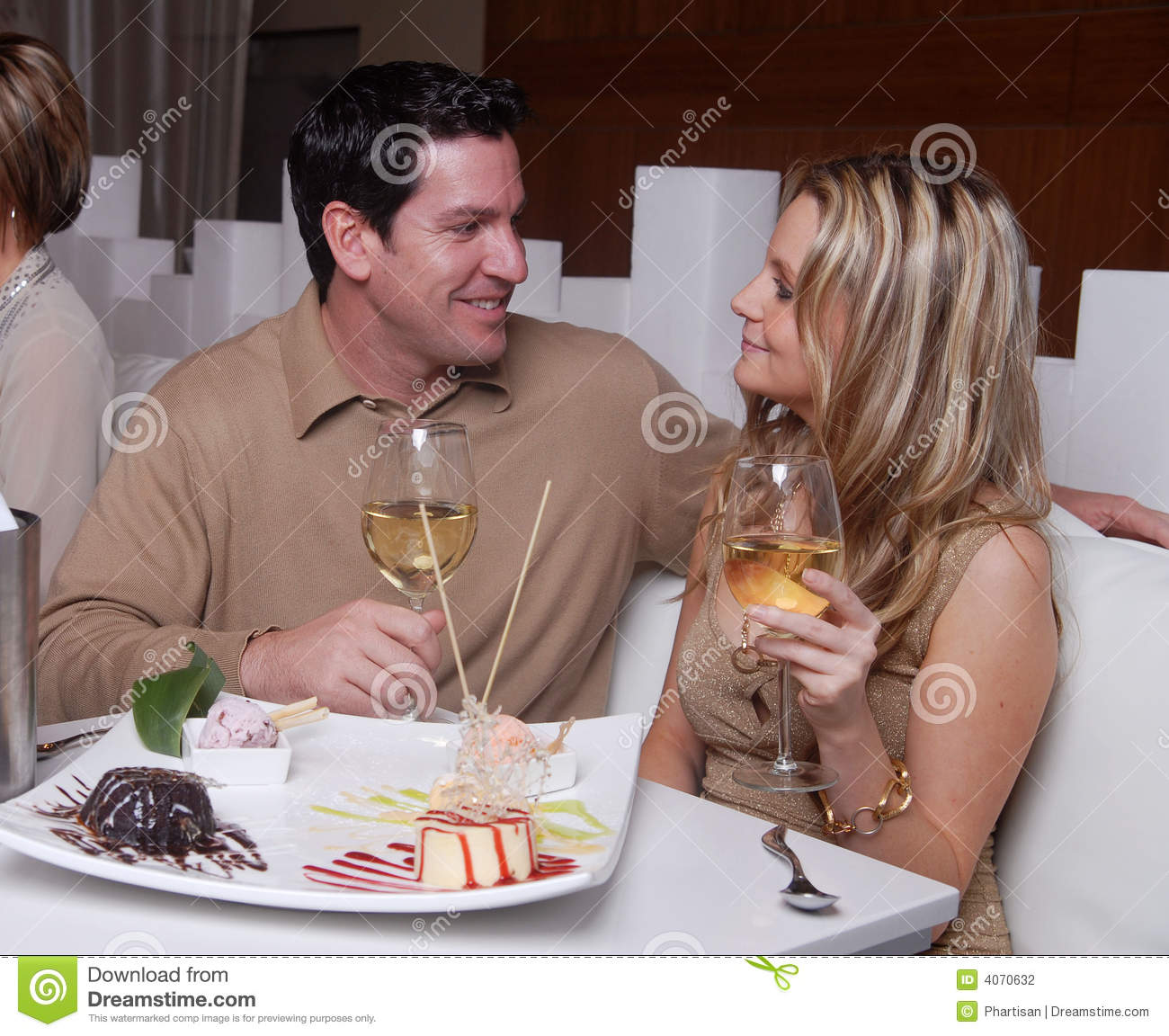 Couple Enjoying Their Summer Holidays Stock Photo: Young Couple Enjoying Dessert In A Rest Stock Photography