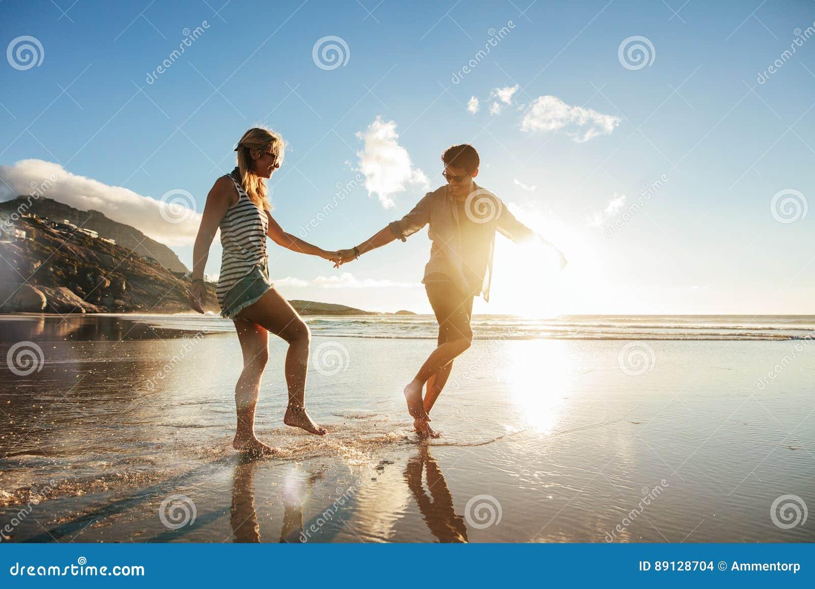 Young couple enjoying holidays on the sea shore