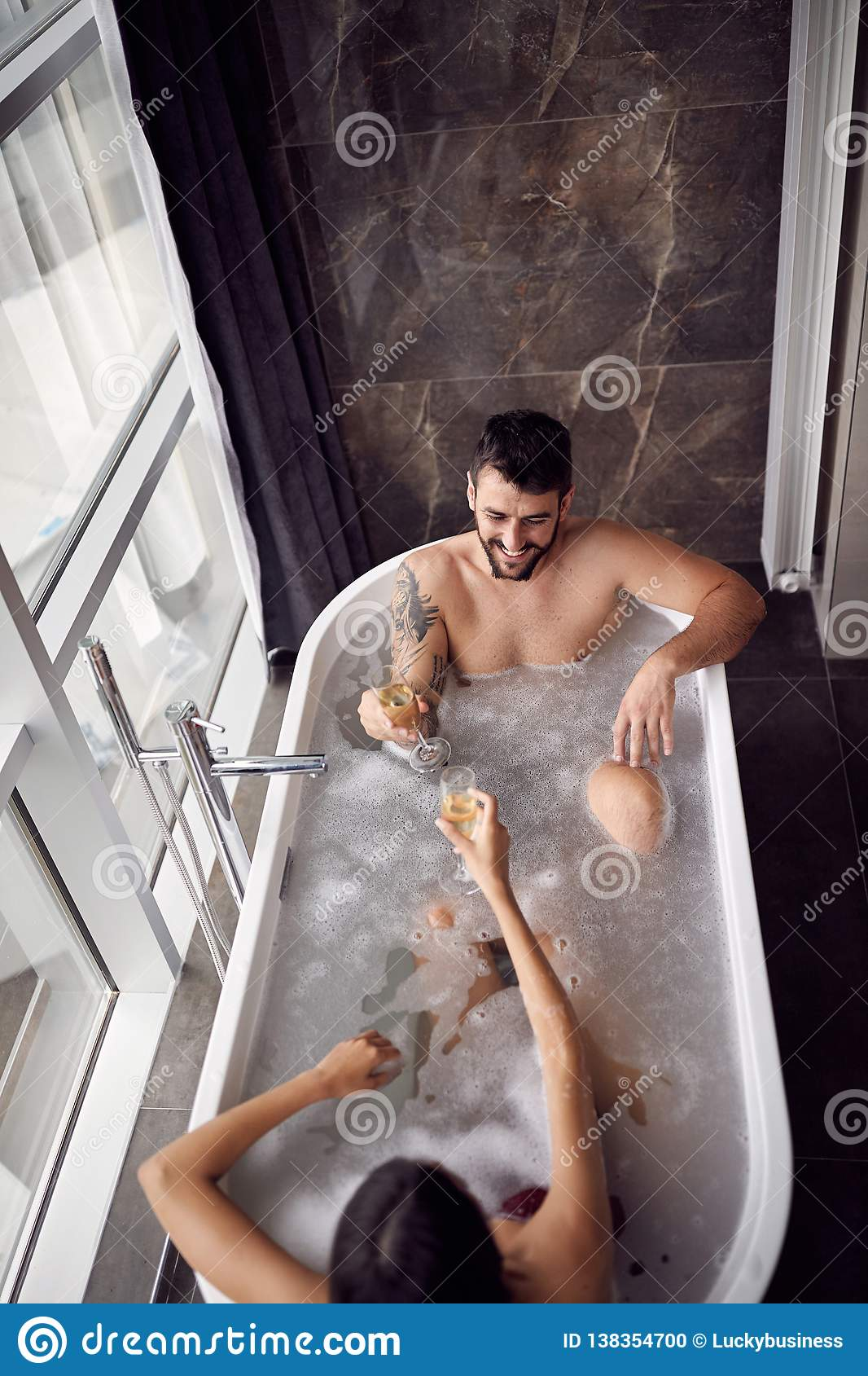 Couple Enjoying And Relaxing In The Bathtub And Drinking Champagne Top View Stock Photo Image Of Relaxing Love 138354700