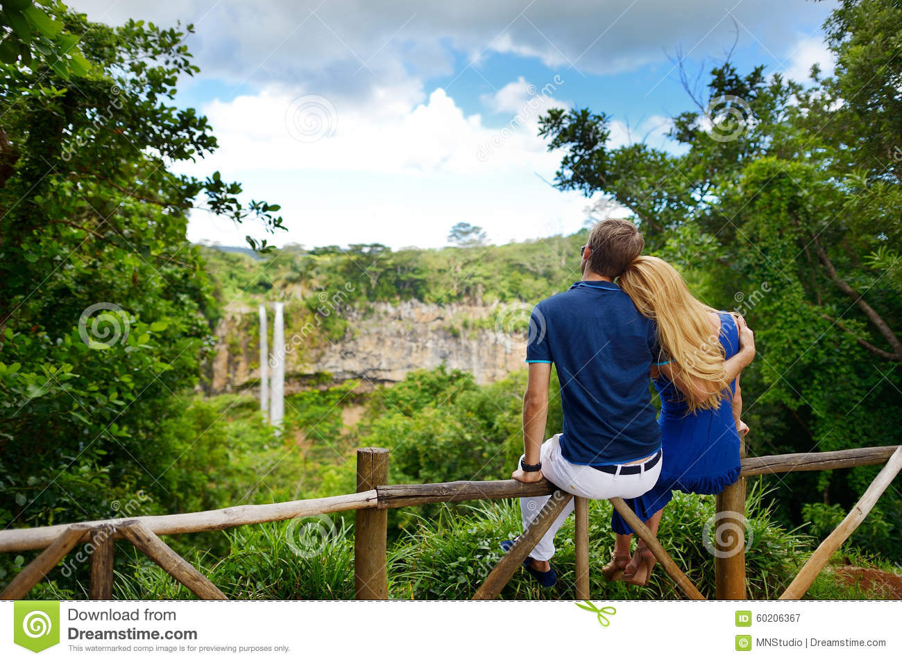 Young couple enjoying a view on Chamarel falls of Mauritius