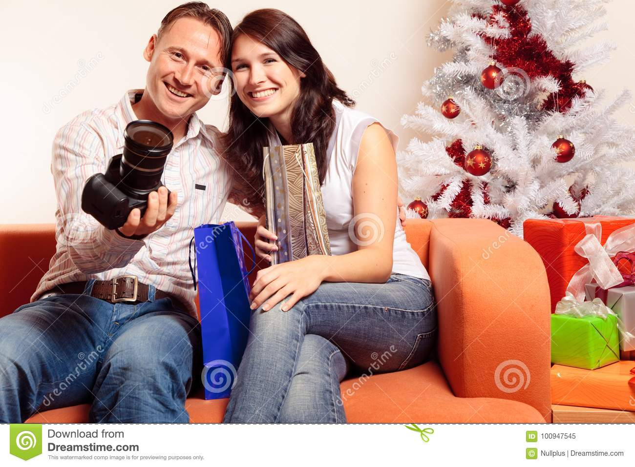 download young couple exchanging christmas gifts stock image image of smiling adult 100947545