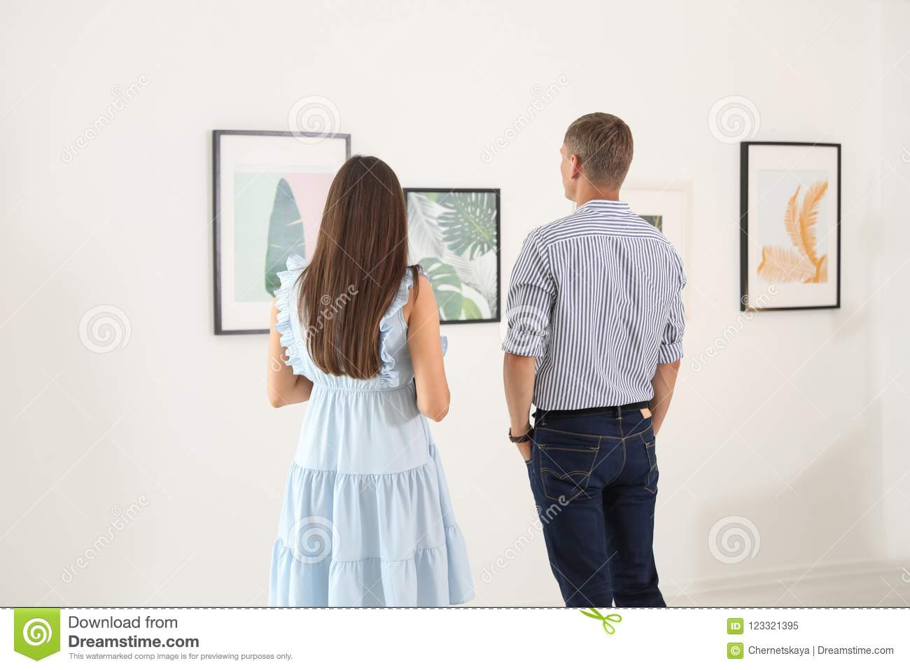 Young couple at exhibition