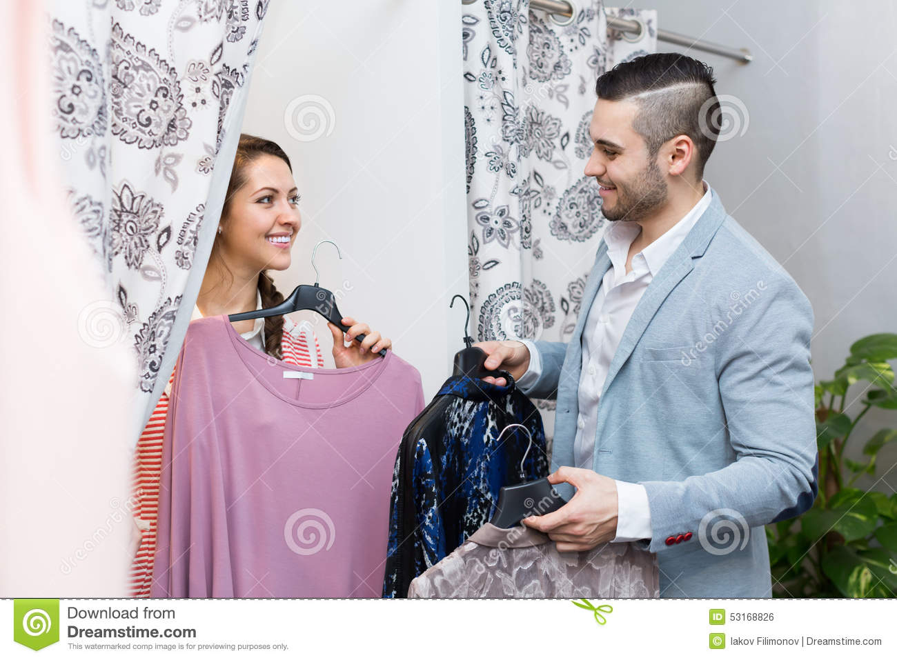 Couple In Clothing Store Stock Photo | Getty Images