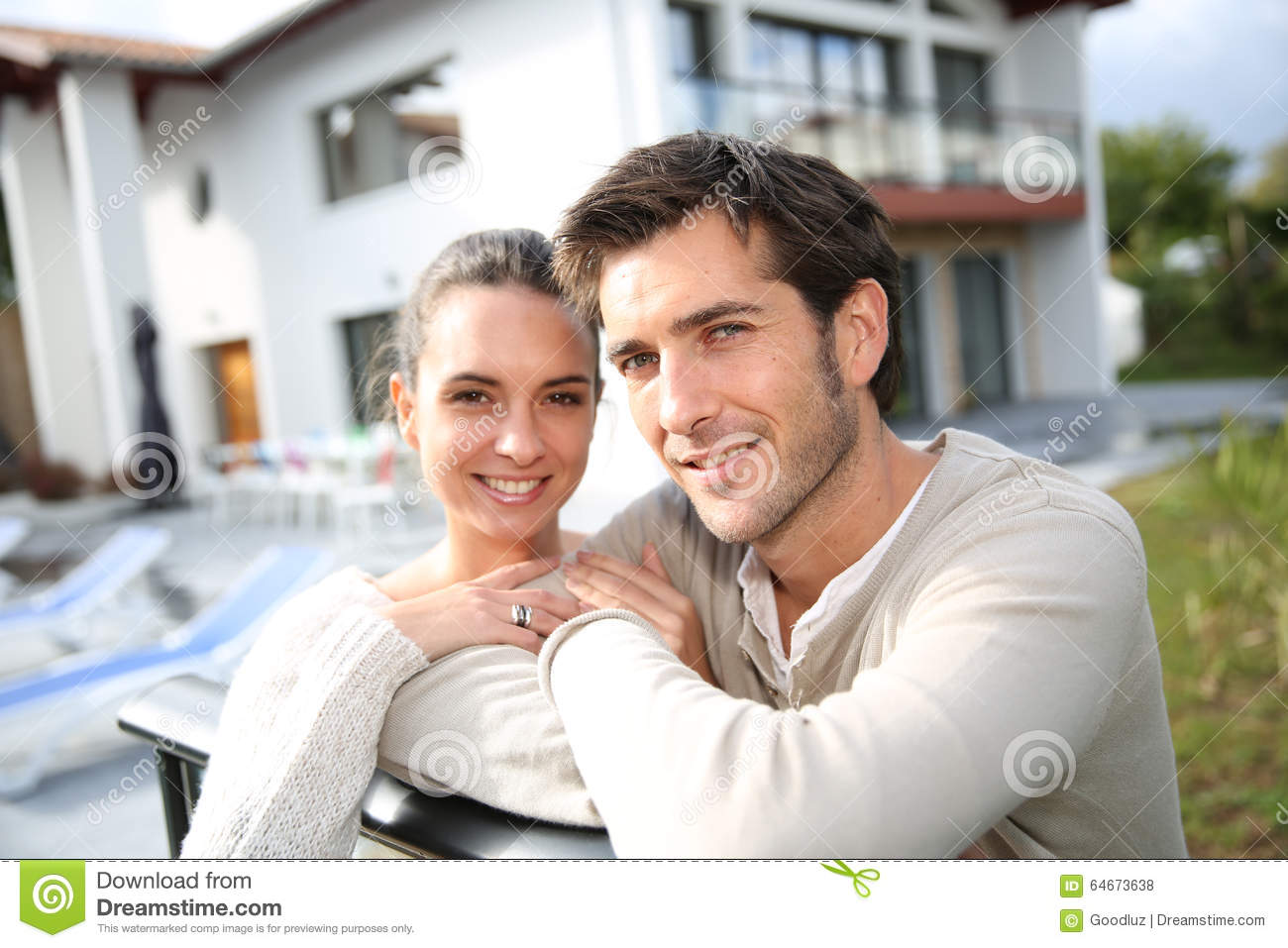Young family standing in front of their house royalty free stock image 21659752 - Young couple modern homes ...