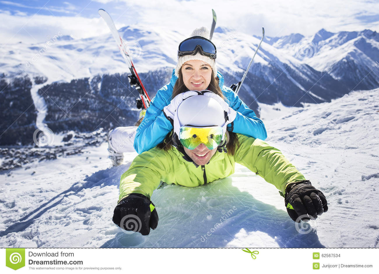 Young Couple Funny Action Winter Ski Resort Stock Photo