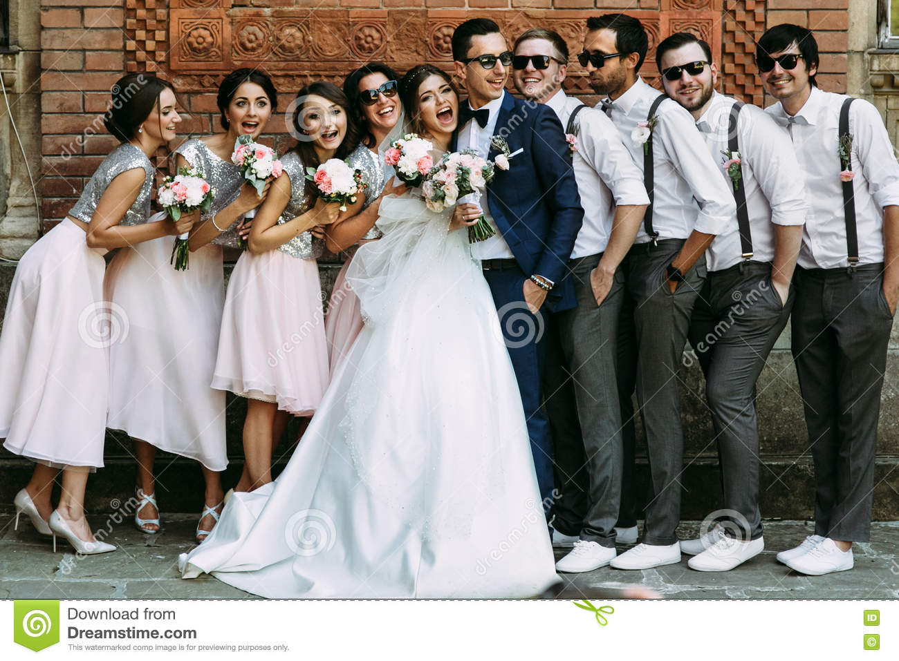 Wedding Gifts For Young Couples: Young Couple With The Funny Friends On The Wedding Stock