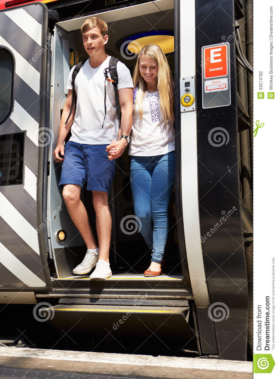 Get To Know Teen Model And Singer Delilah Belle Hamlin: Young Couple Getting Off Train At Platform Stock Photo