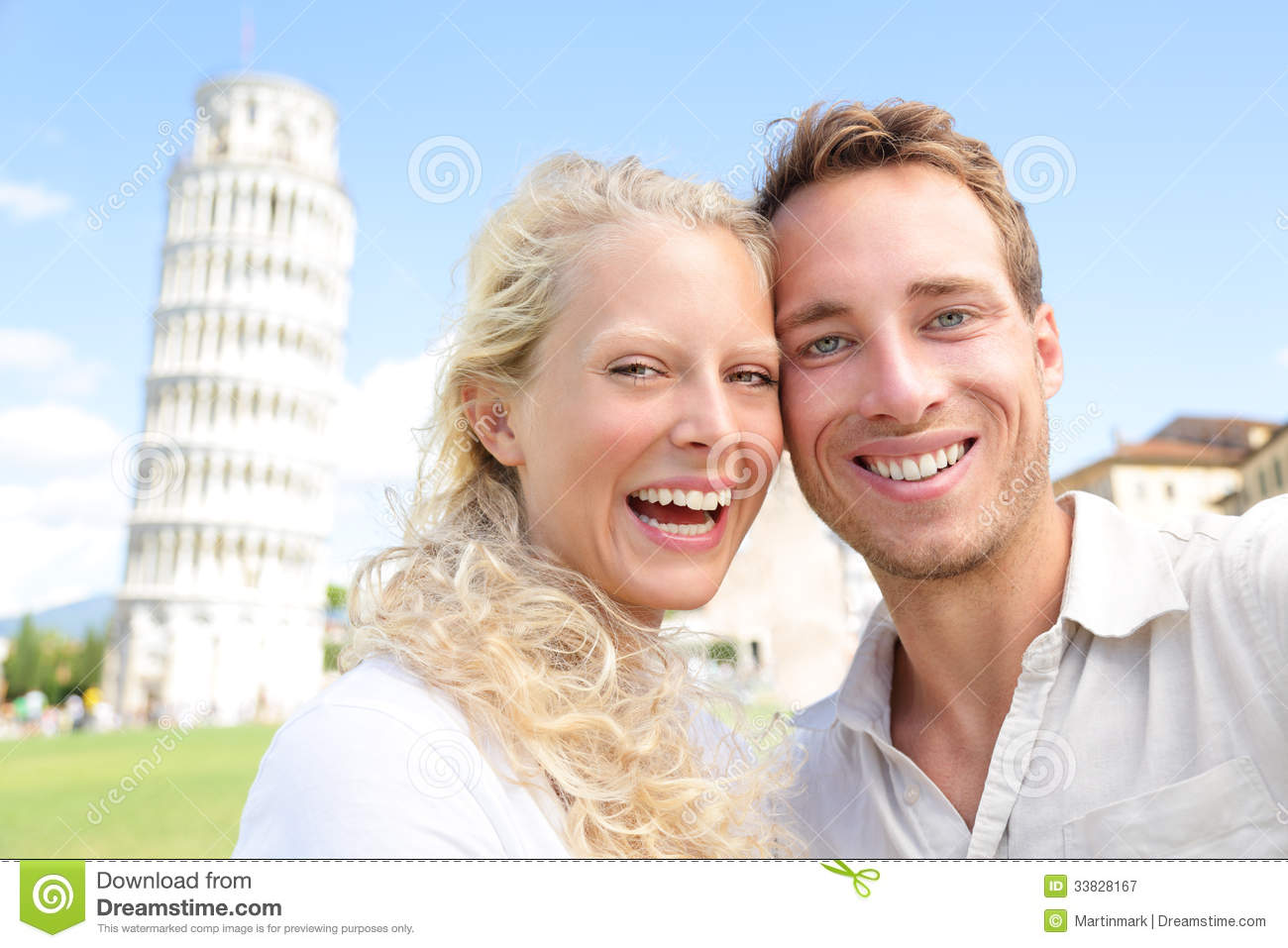 Young couple happy having fun on travel to Pisa