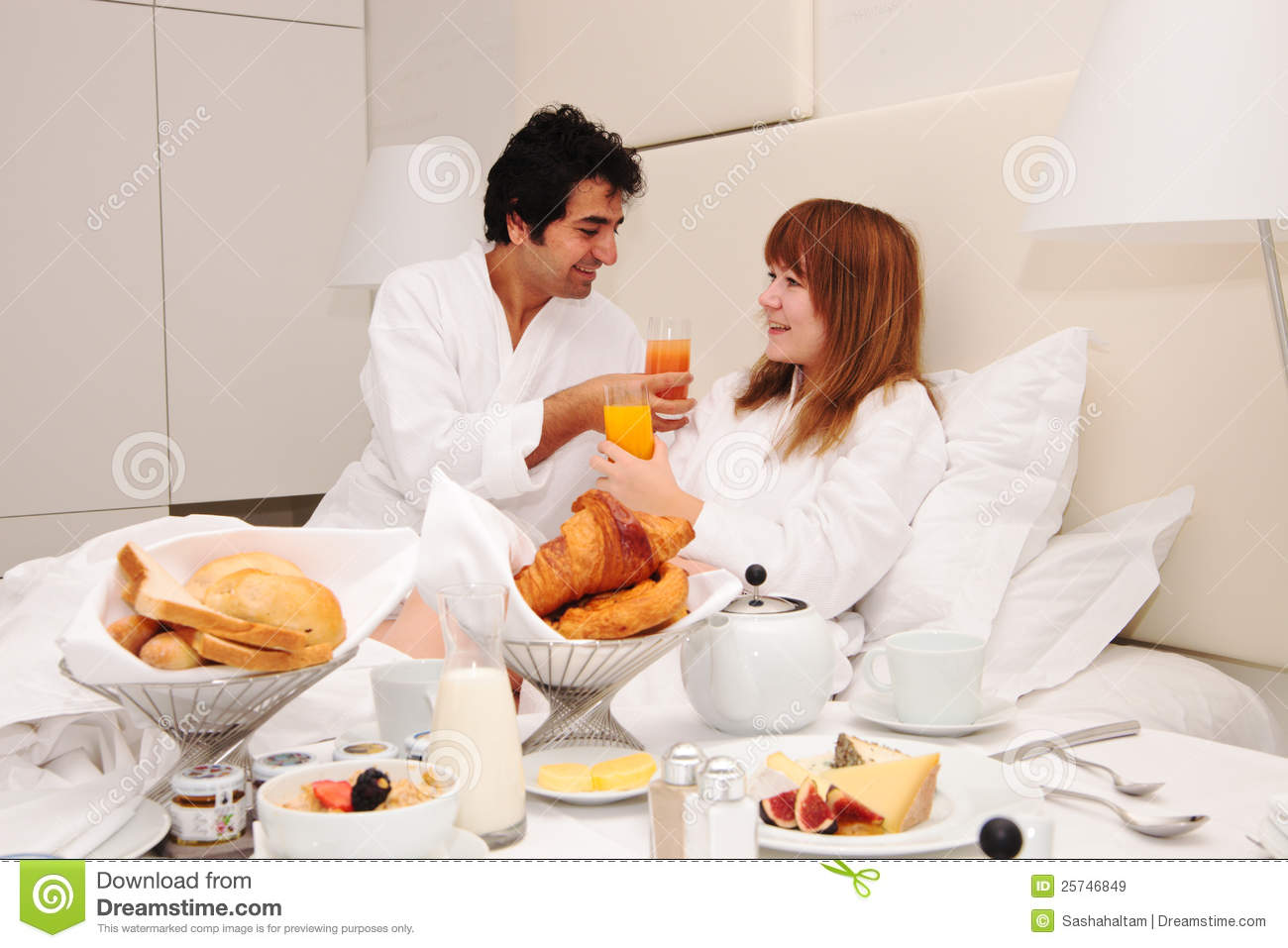 Young couple having breakfast in bed stock image image for A bed and breakfast
