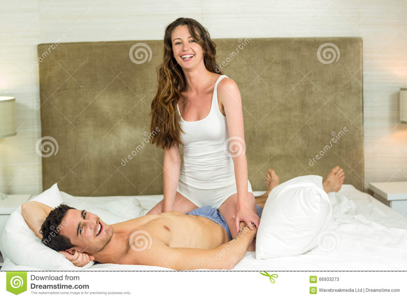 in bed couple Young