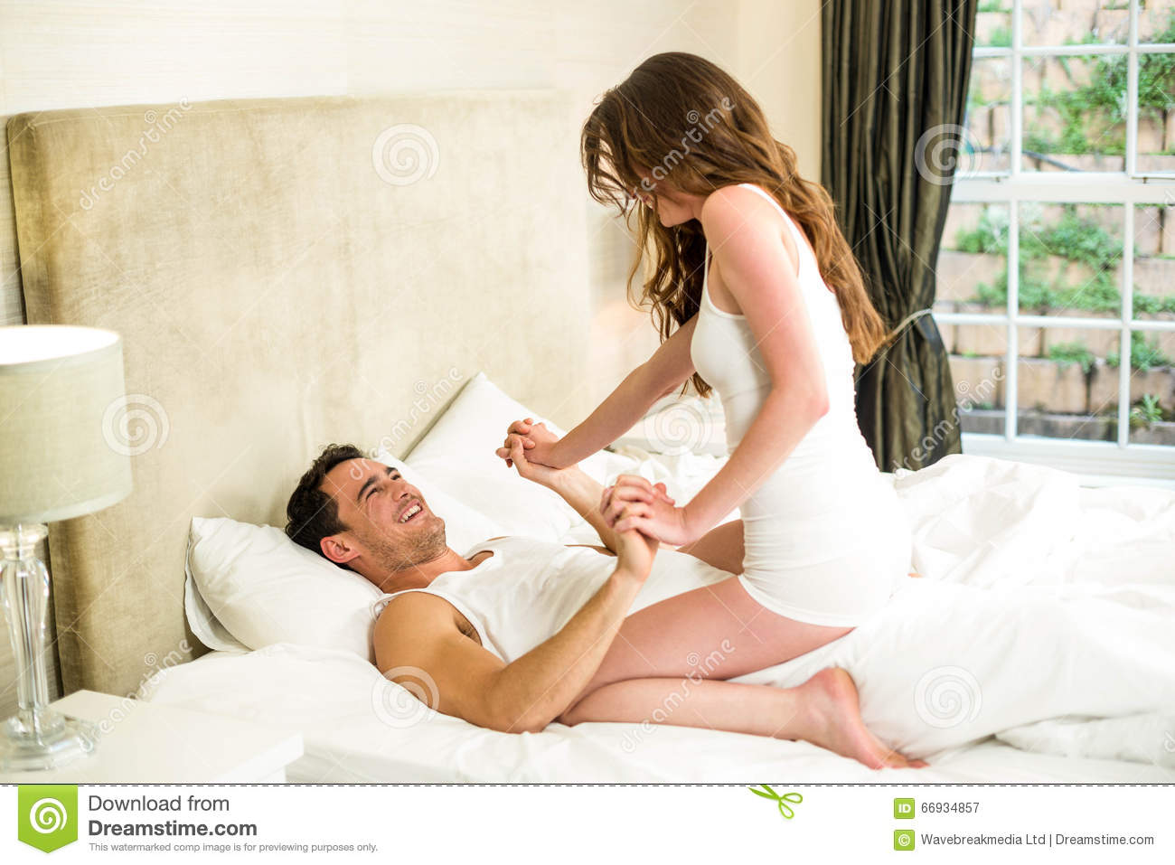 Royalty Free Stock Photo. Young Couple Having Fun On Bed Stock Image   Image  66934857