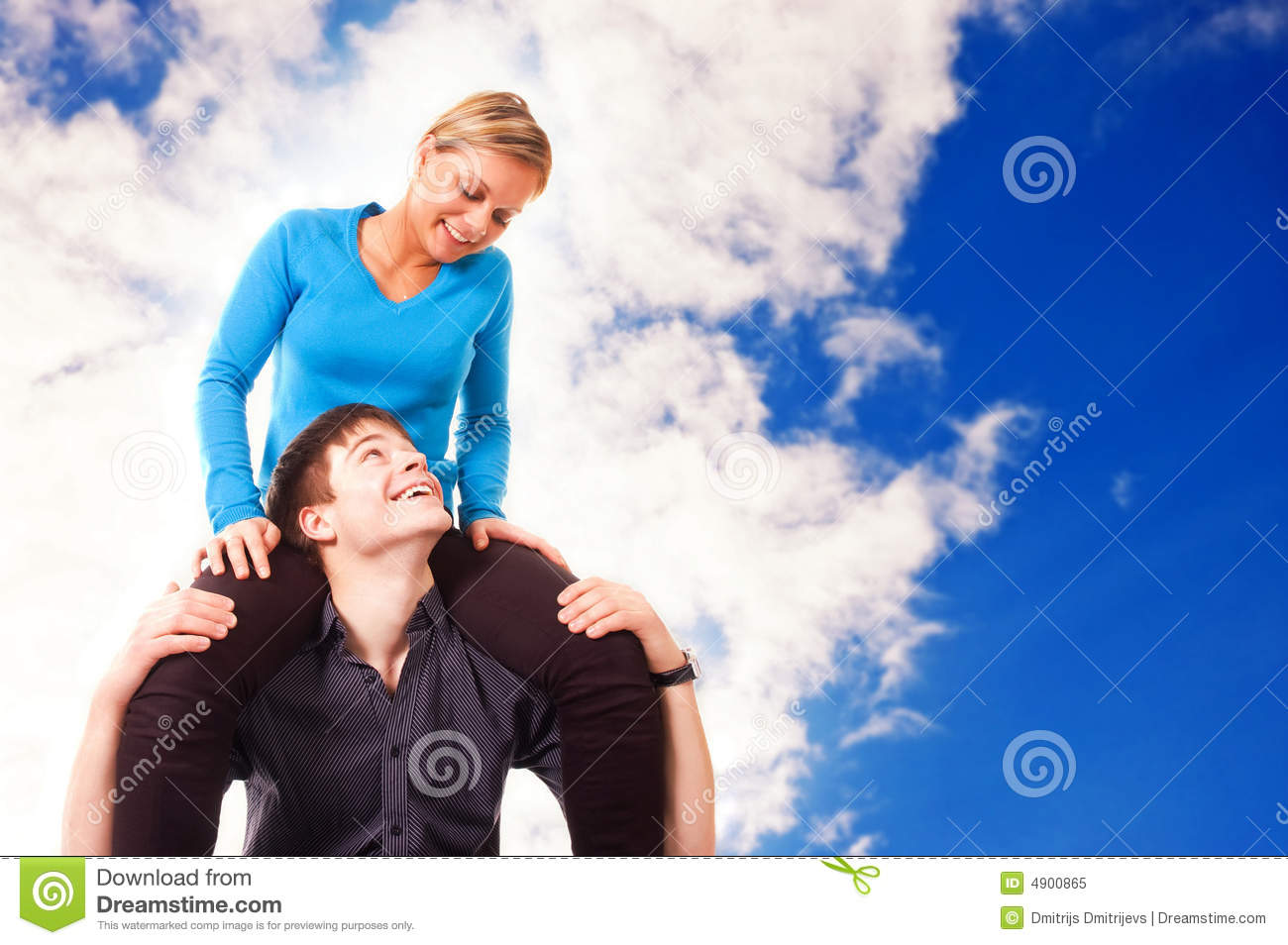 Young couple is having fun (blue sky background)