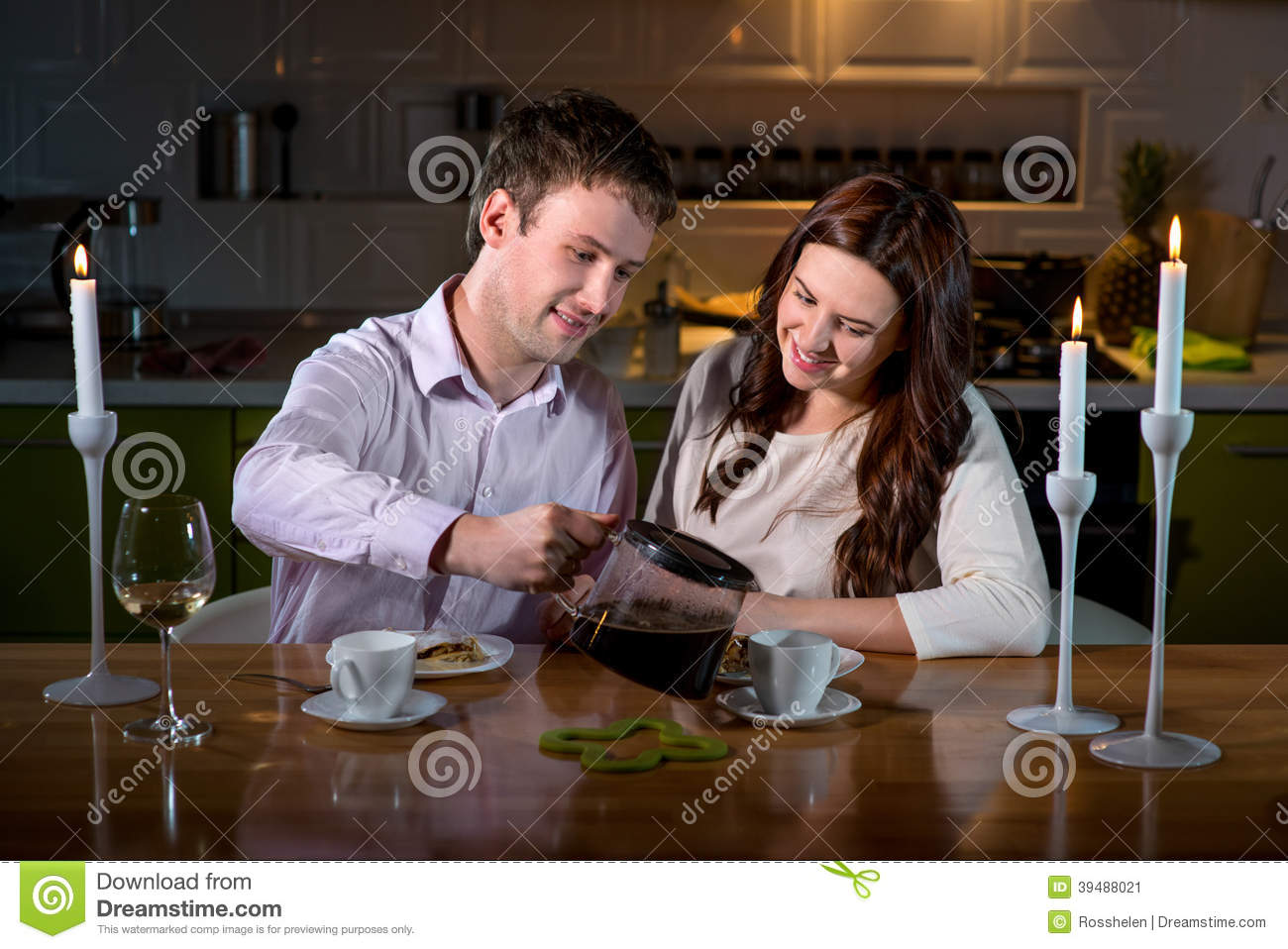 Young Couple Having Romantic Dinner On The Dinner Table At Home ...