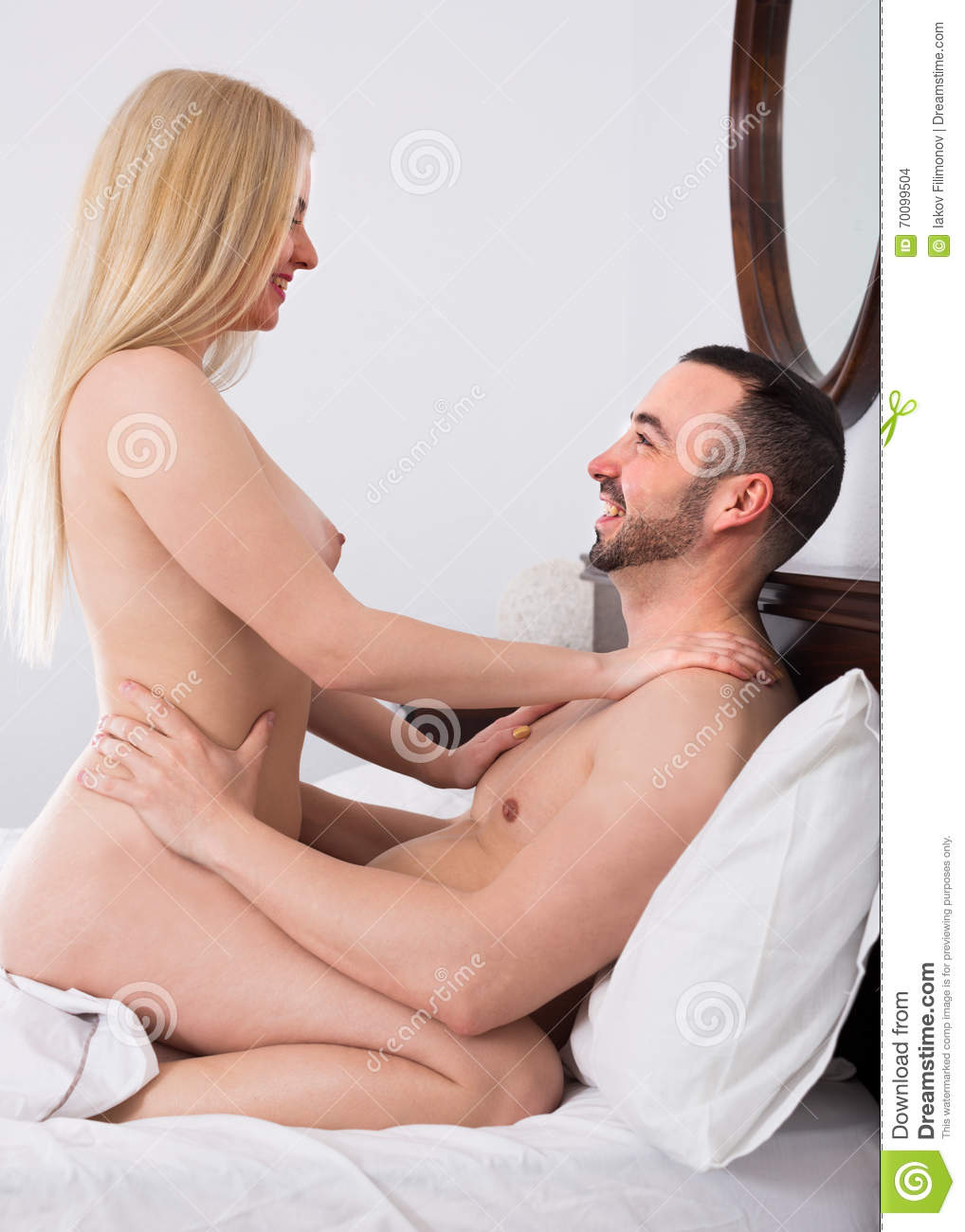Young couple having sex on bed