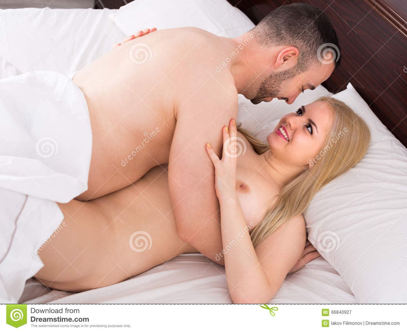 Naked couple sex on bed