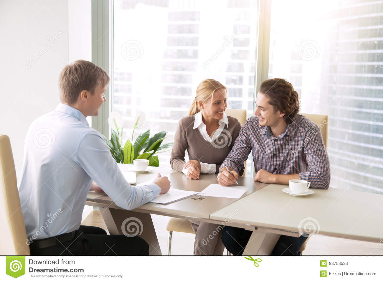 Young couple having a talk with agent