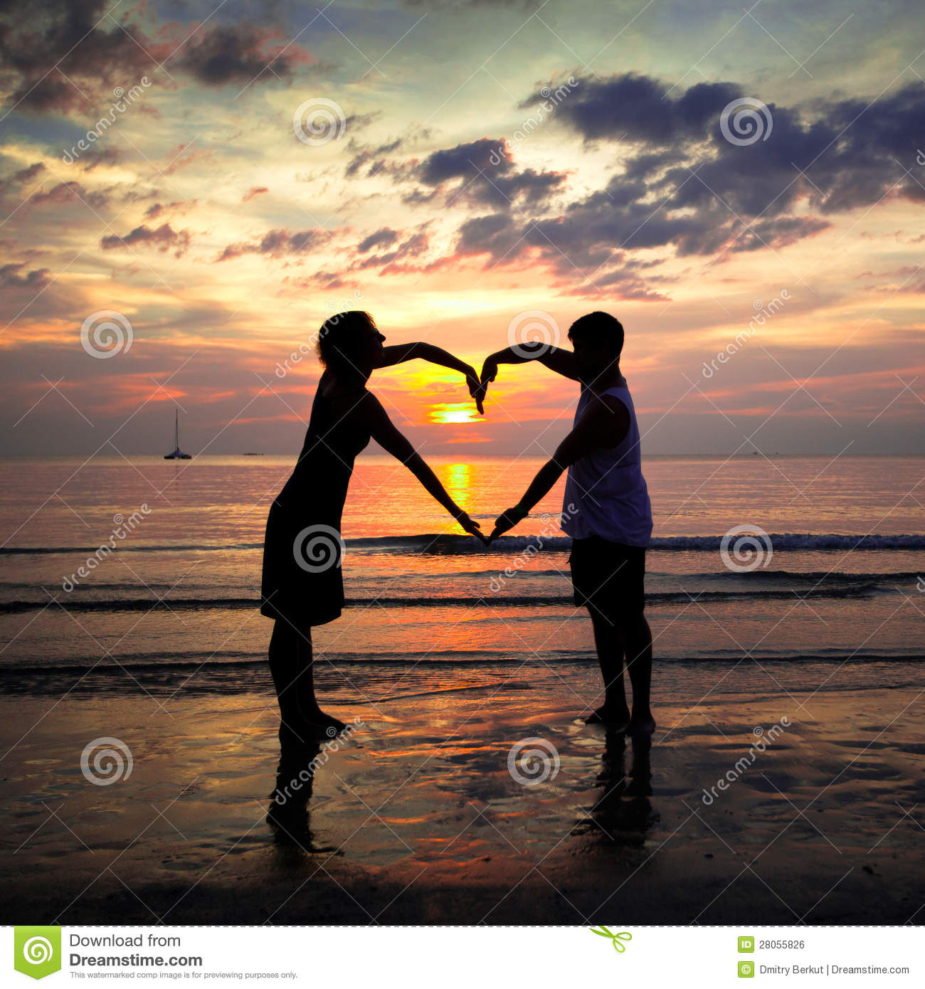 Young Couple Holding Hands Heart-shaped At Sunset Stock Photo ... for Couple Holding Hands Silhouette Sunset  61obs