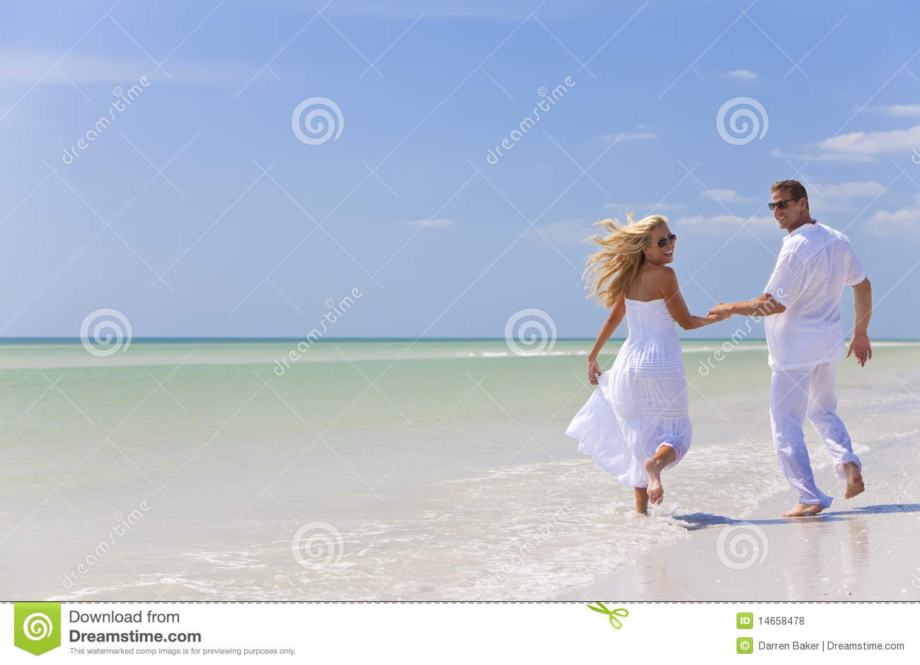 Young Couple Holding Hands on A Tropical Beach