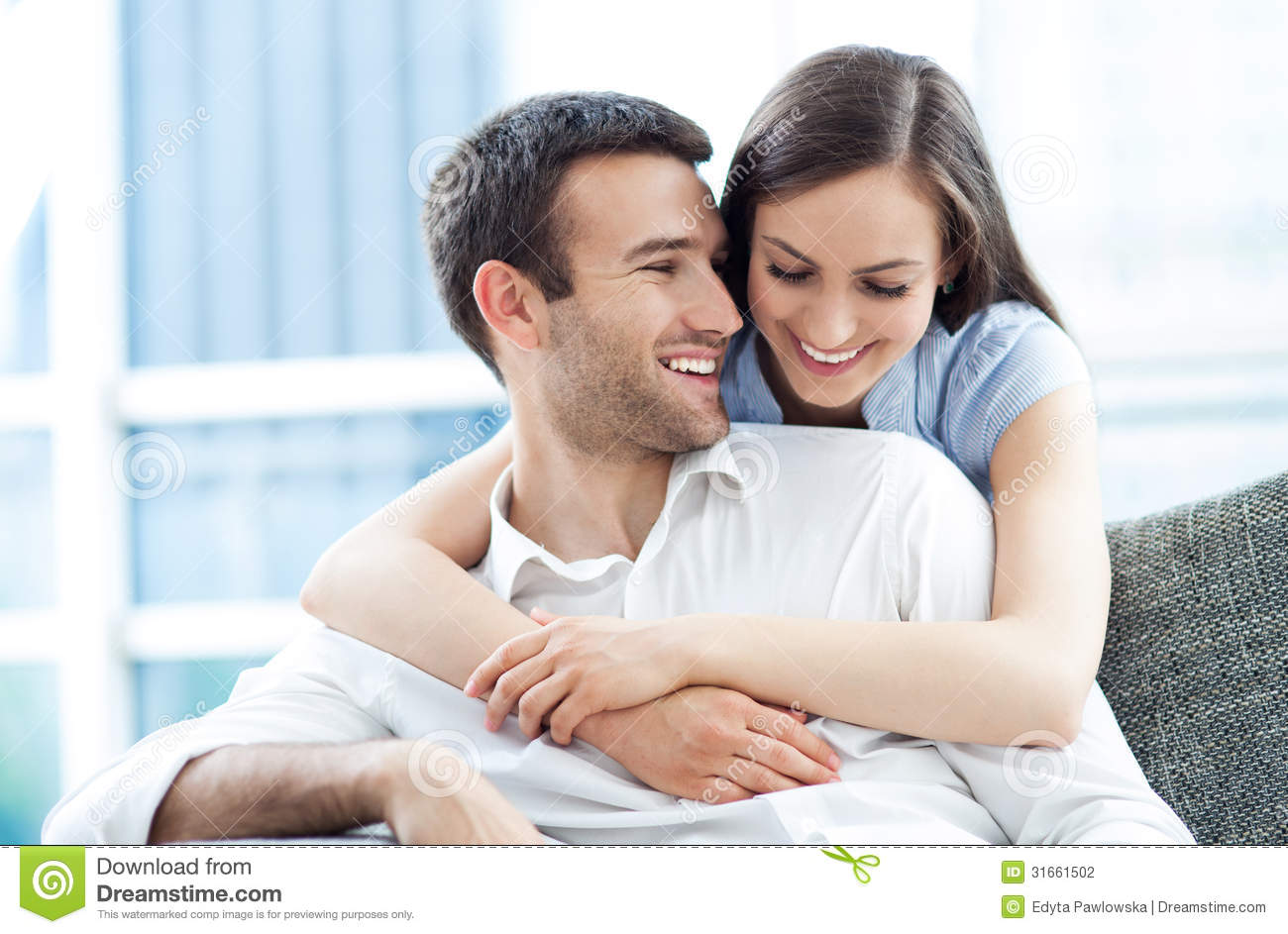 Young Couple Hugging S...