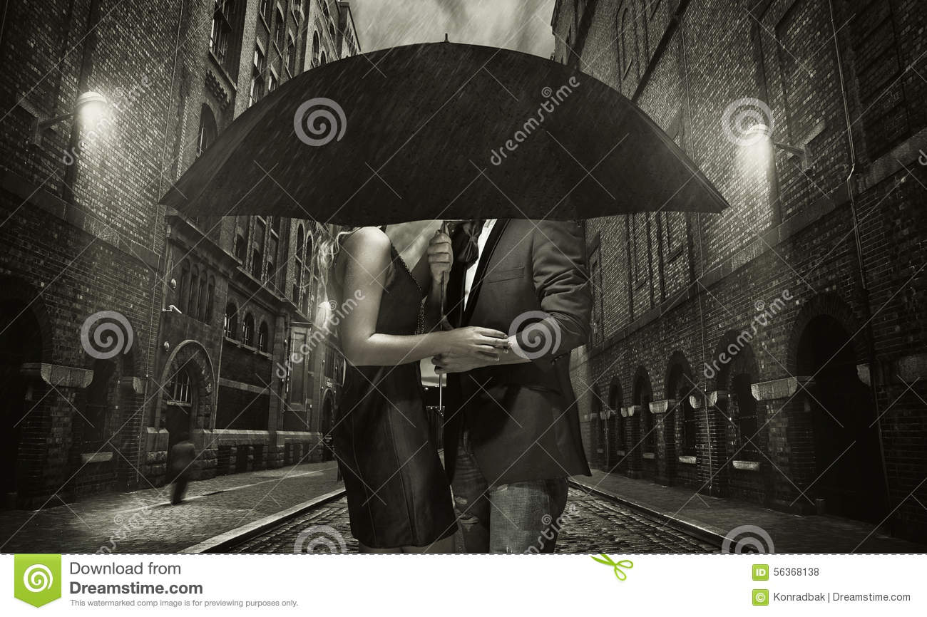 Young couple hugging in the heavy rain