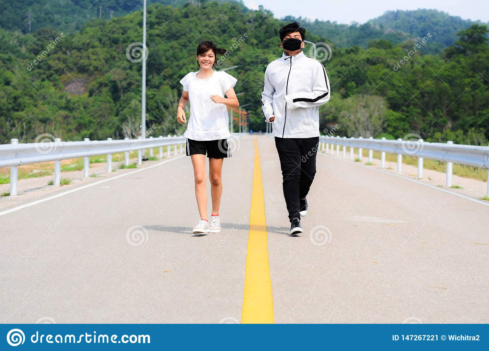 Young couple jogging in park. Health and fitness