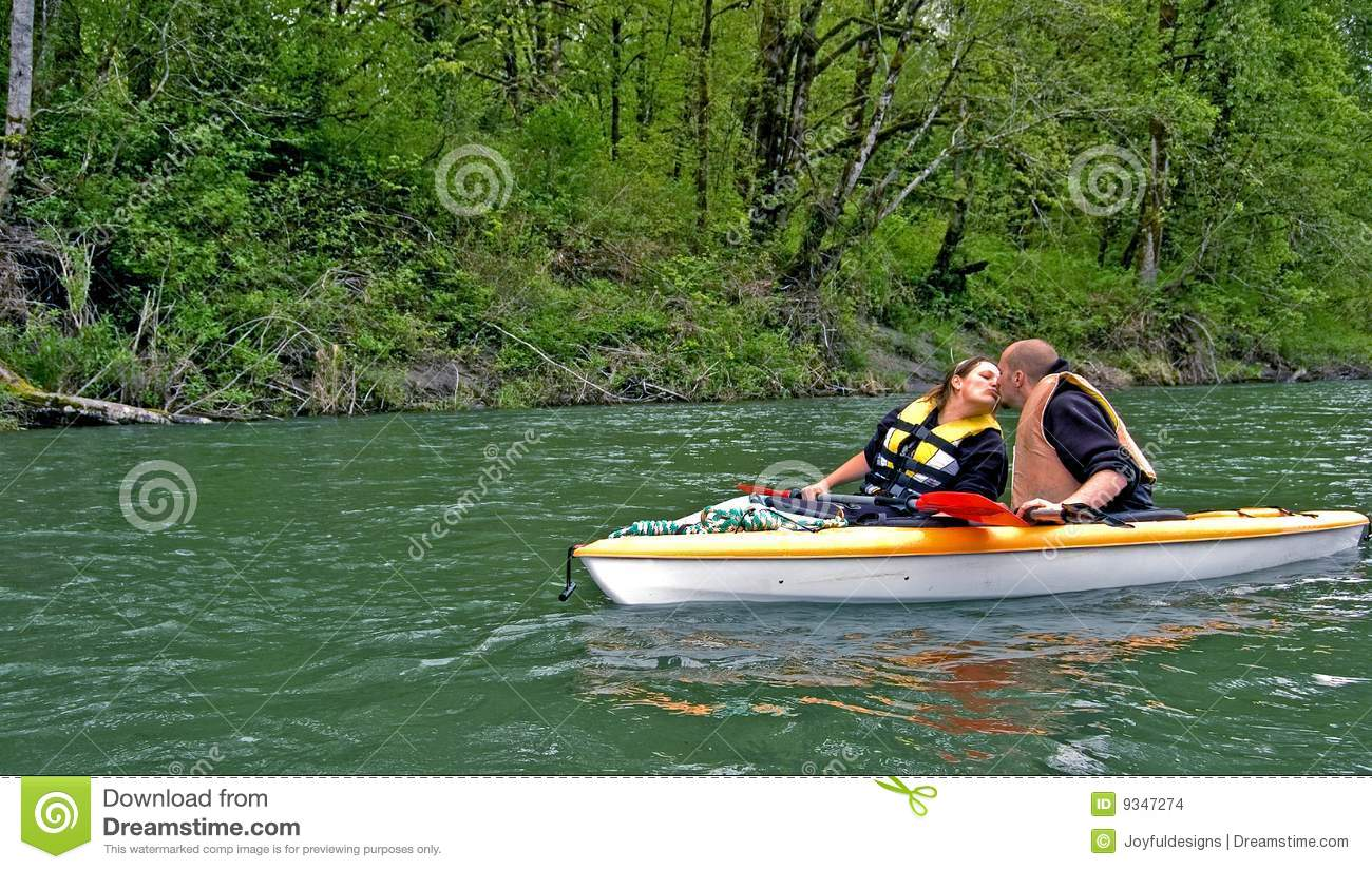 Young Couple Kiss While Kayaking Stock Images - Image: 9347274