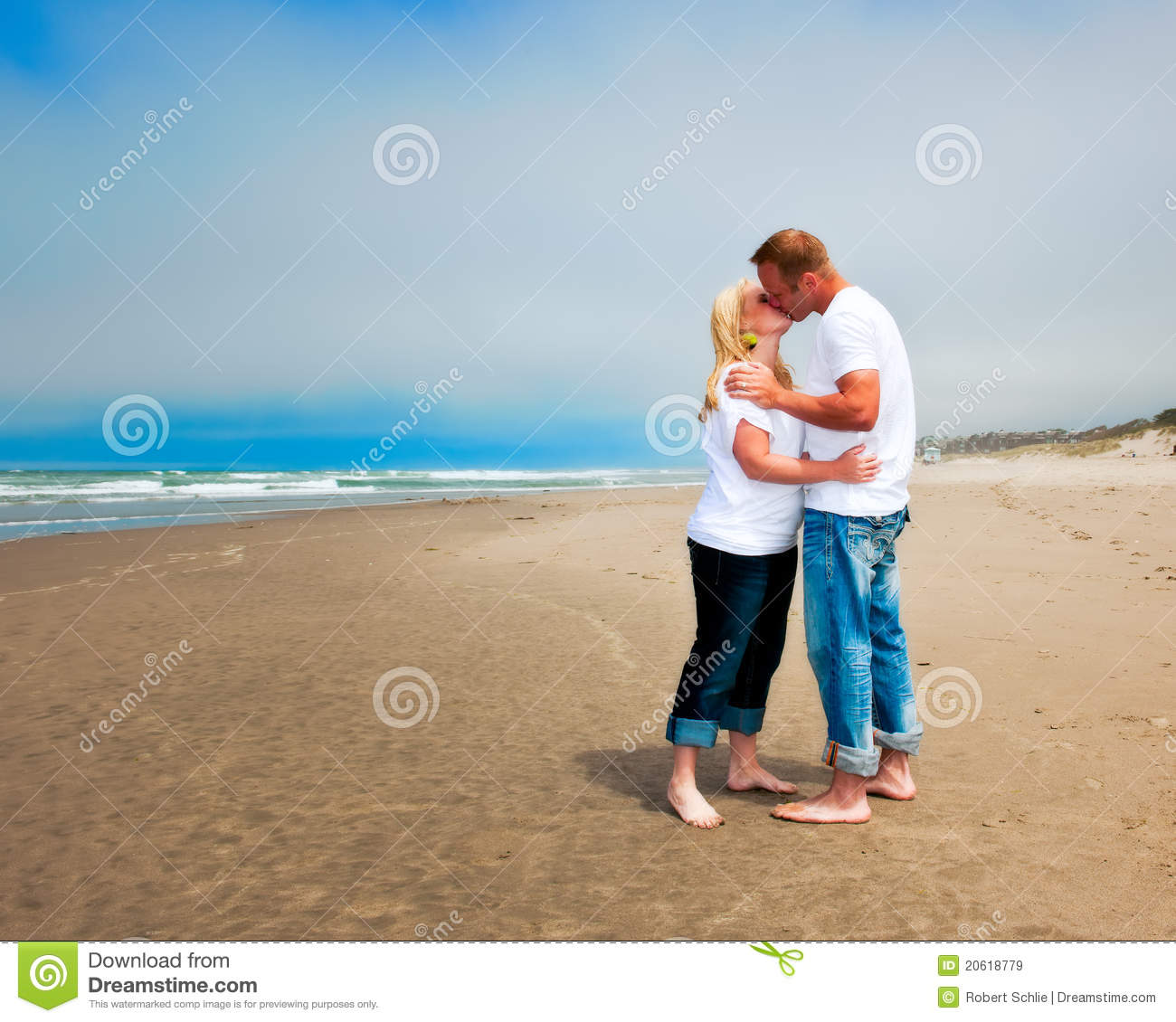 Young Couple Kissing On The Beach Stock Image