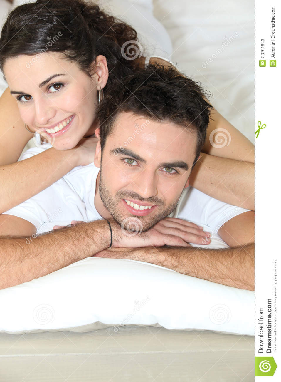 young couple laying in bed stock photos image 23791843. Black Bedroom Furniture Sets. Home Design Ideas