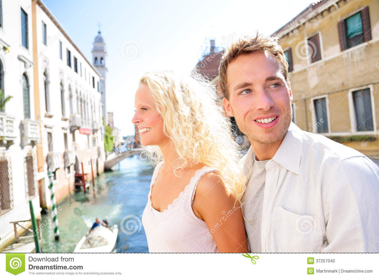 Young couple lifestyle walking in venice on travel together happy