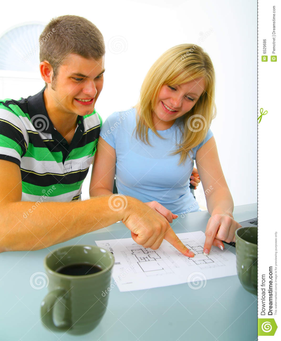 Young Couple Looking At Floor Plan