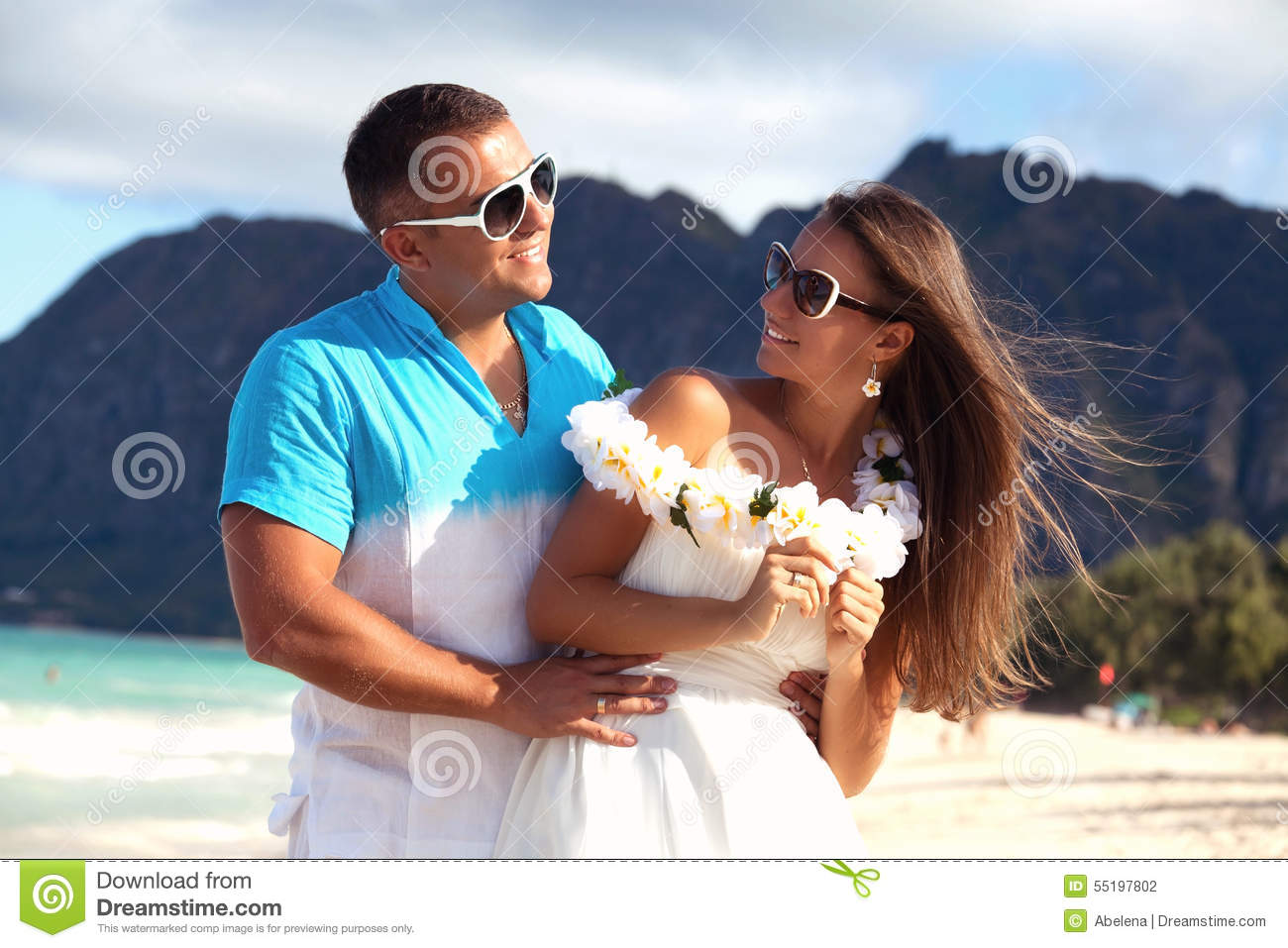 Young couple in love feeling happy on the hawaiian beach for Tropical vacations for couples