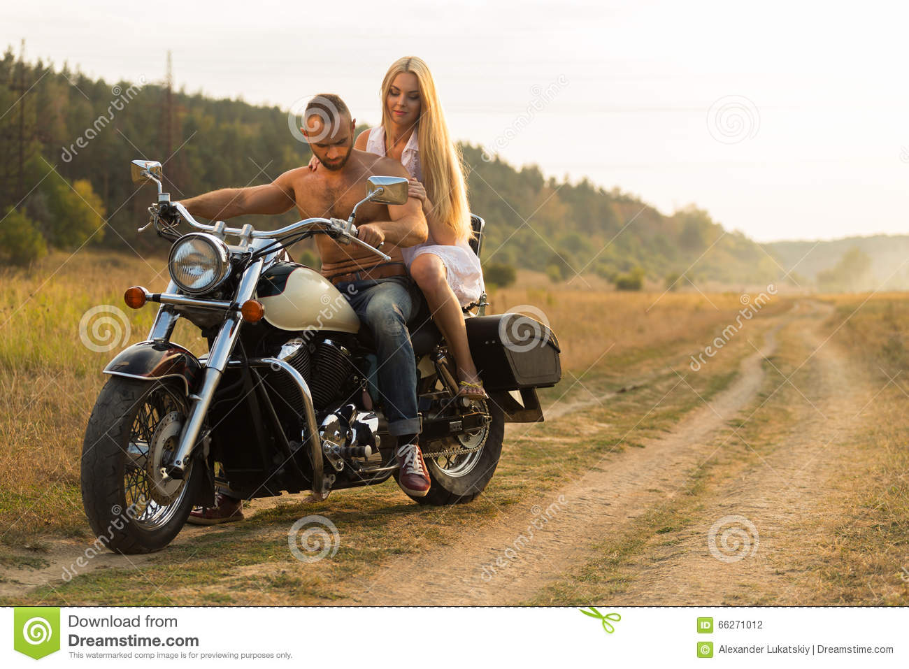 motorcycle love pics  A Young Couple In Love On A Motorcycle In The Field Stock Photo ...