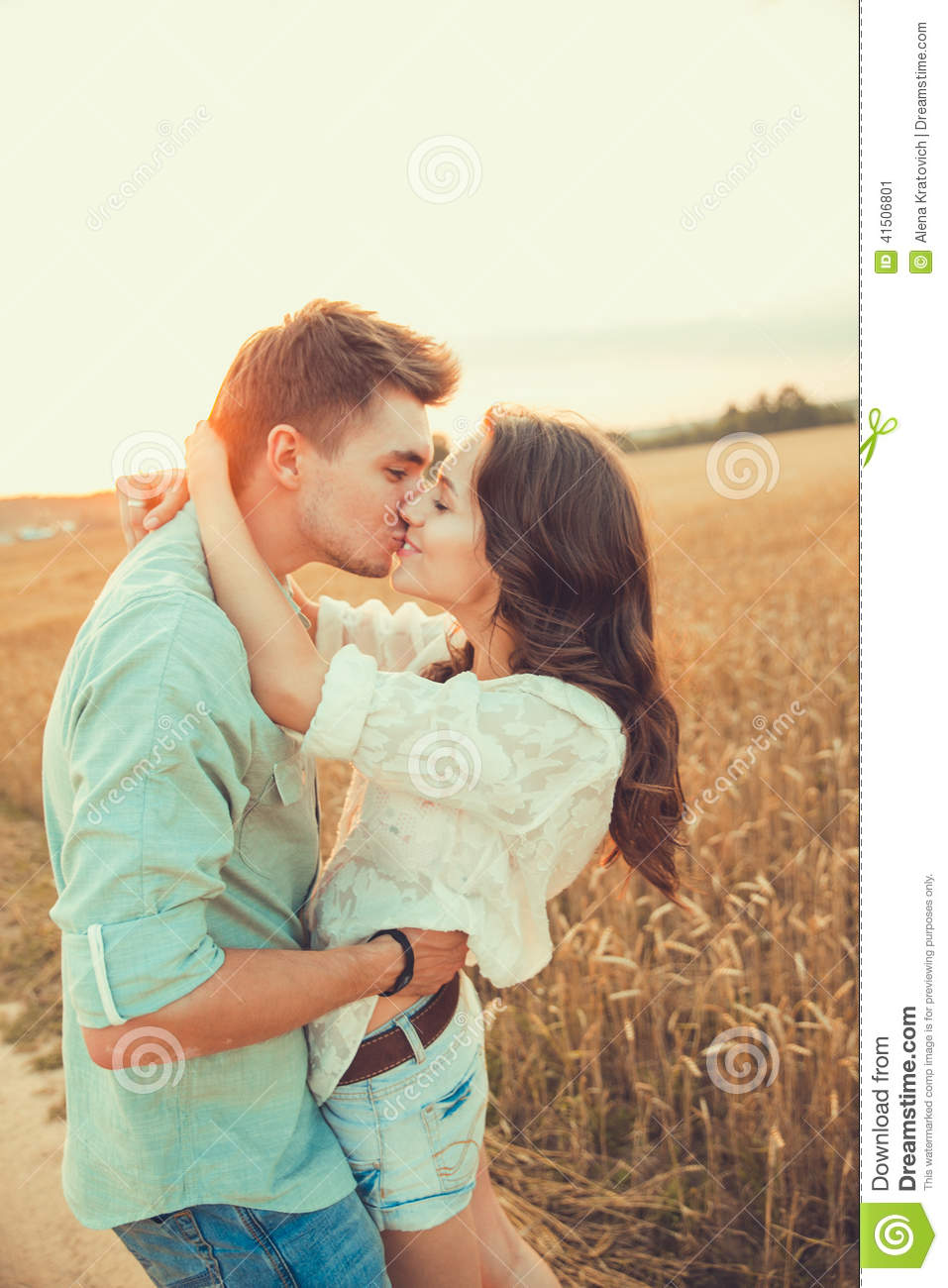 young couple in love outdoor couple hugging and kissing stock image