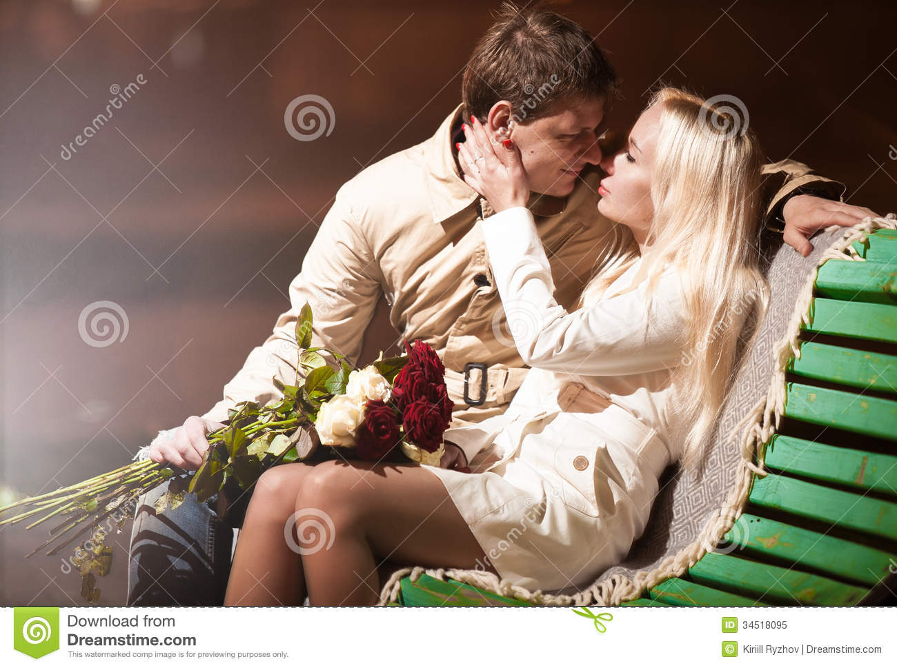 Royalty Free Stock Photo: Young couple in love sitting on bench at ...