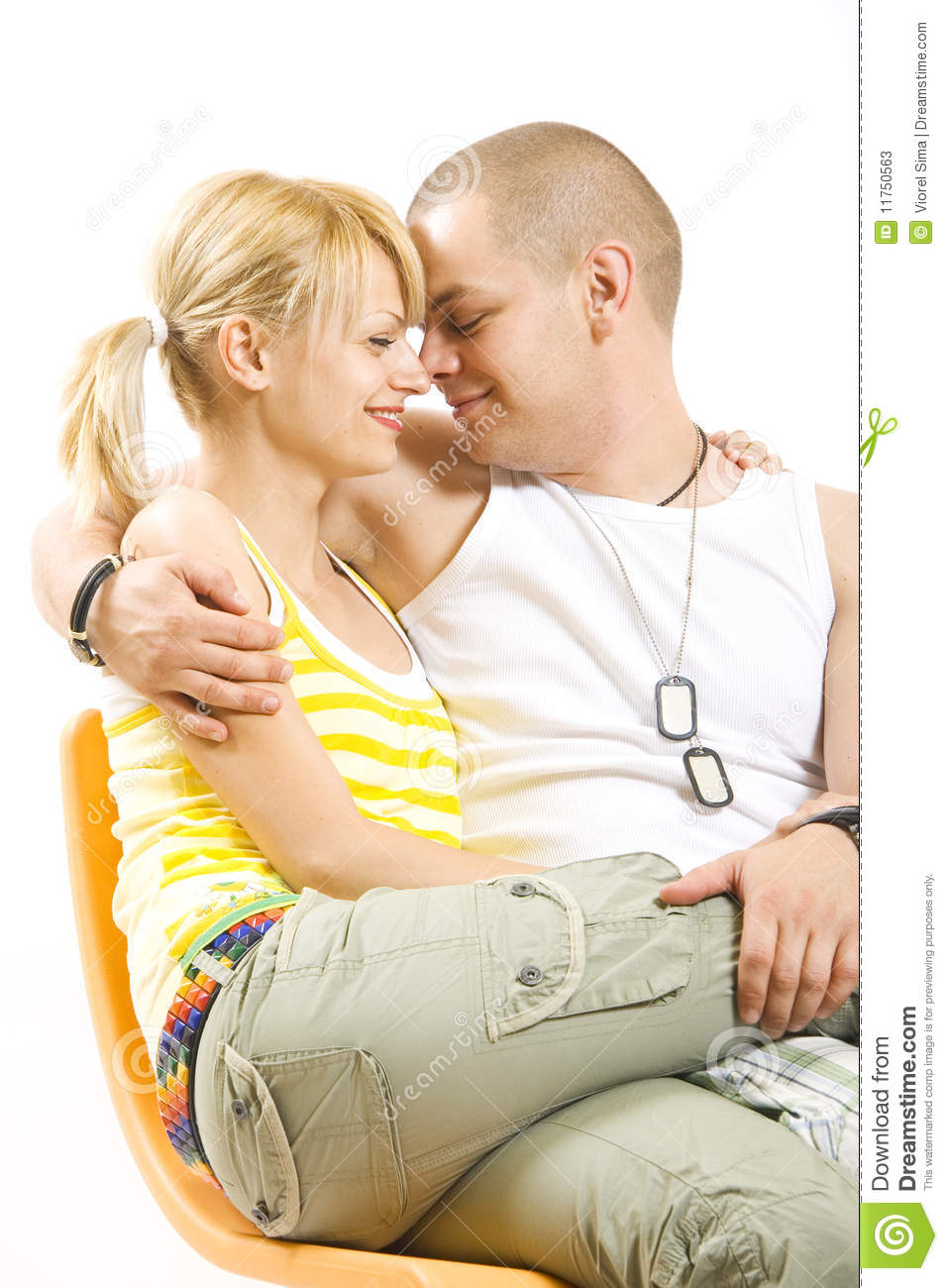young couple in love sitting on the couch stock photos image 11750563. Black Bedroom Furniture Sets. Home Design Ideas