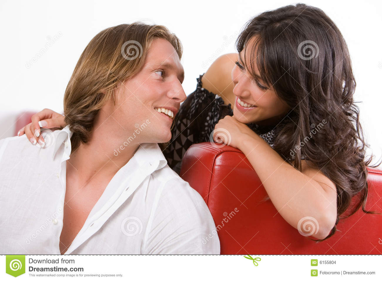 young couple in love sitting on the sofa stock images image 6155804. Black Bedroom Furniture Sets. Home Design Ideas