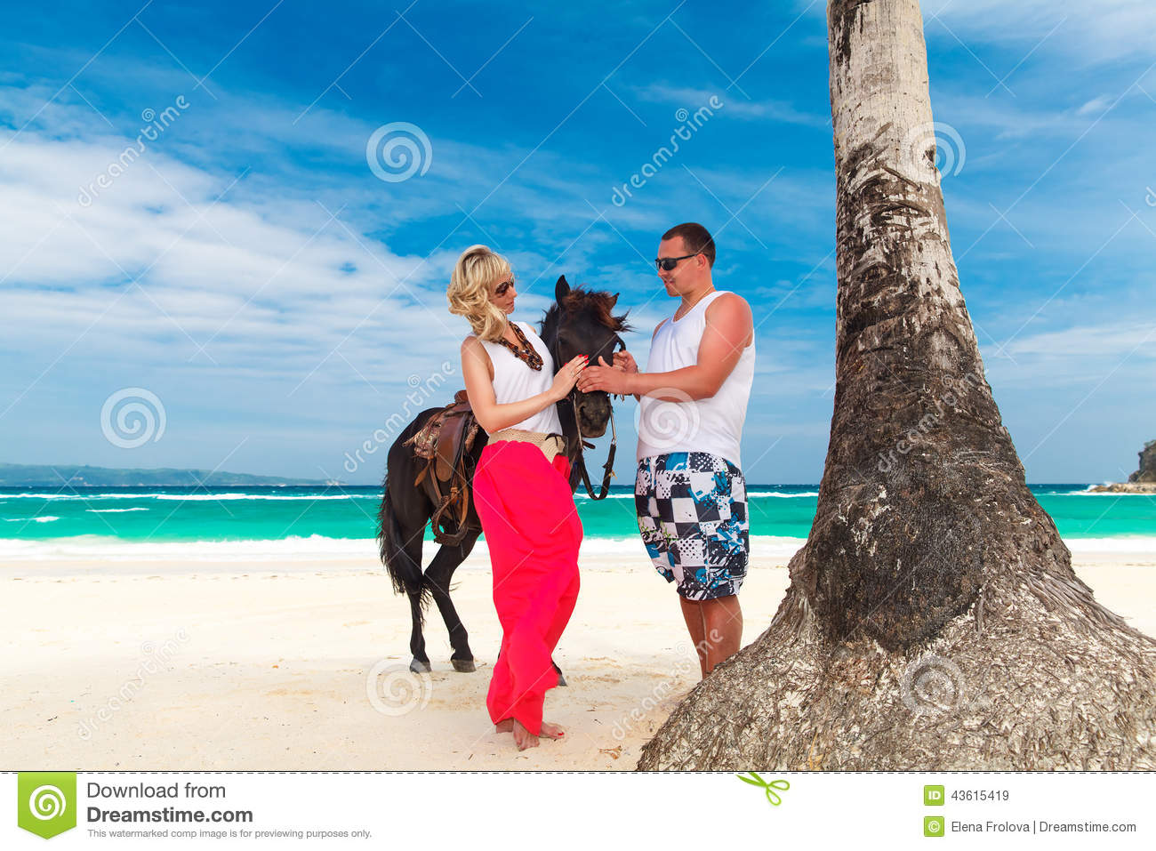 Young couple in love walking with the horse on a tropical for Tropical vacations for couples