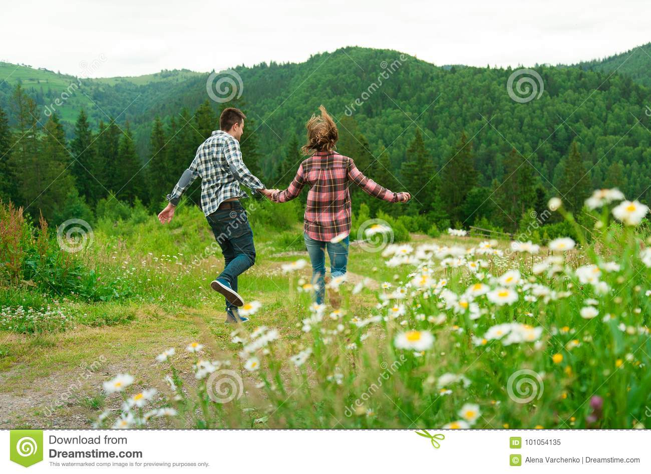 Young couple in love walking in mountains.