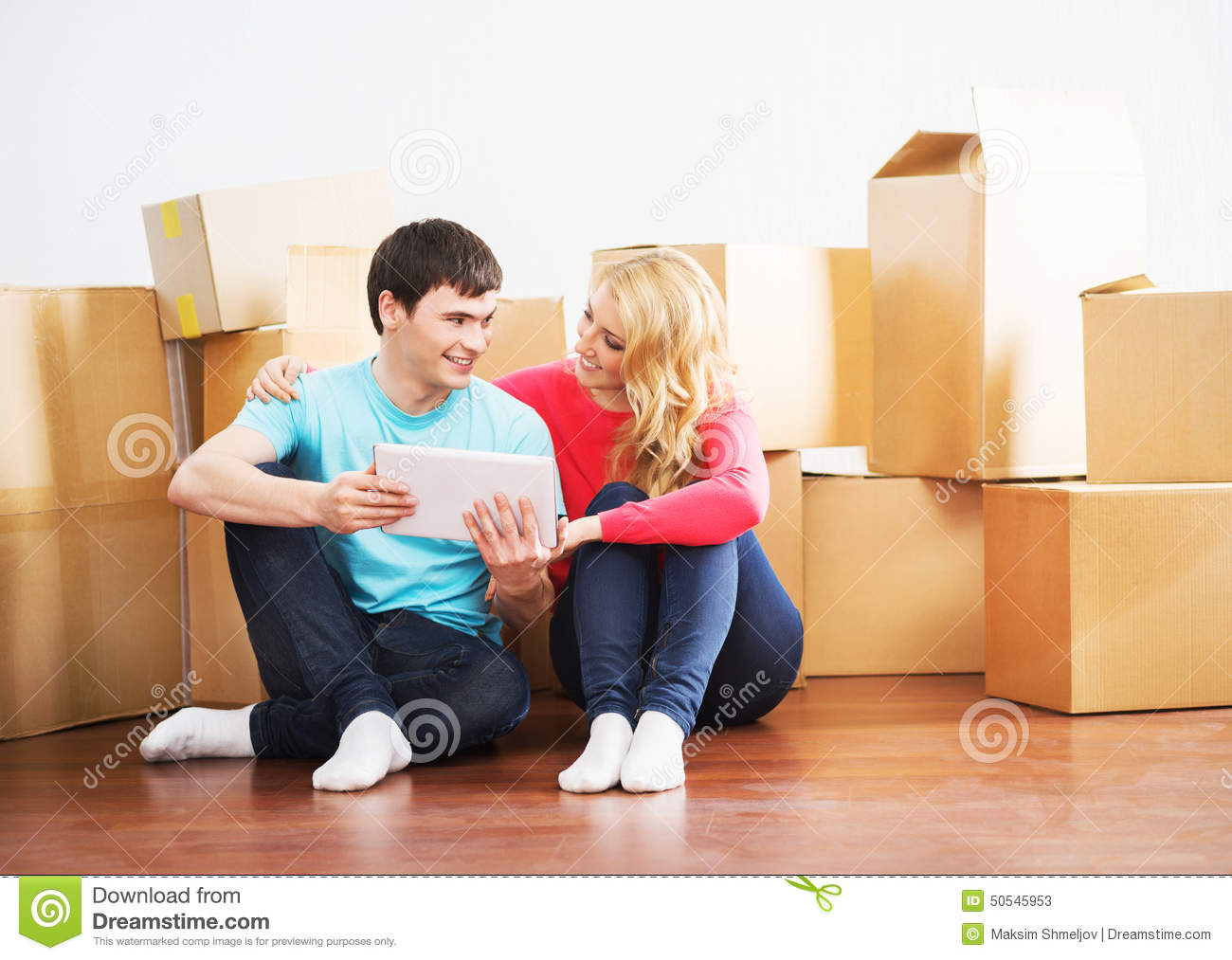 Stock photo moving into new home young couple toast male models picture - Young couple modern homes ...